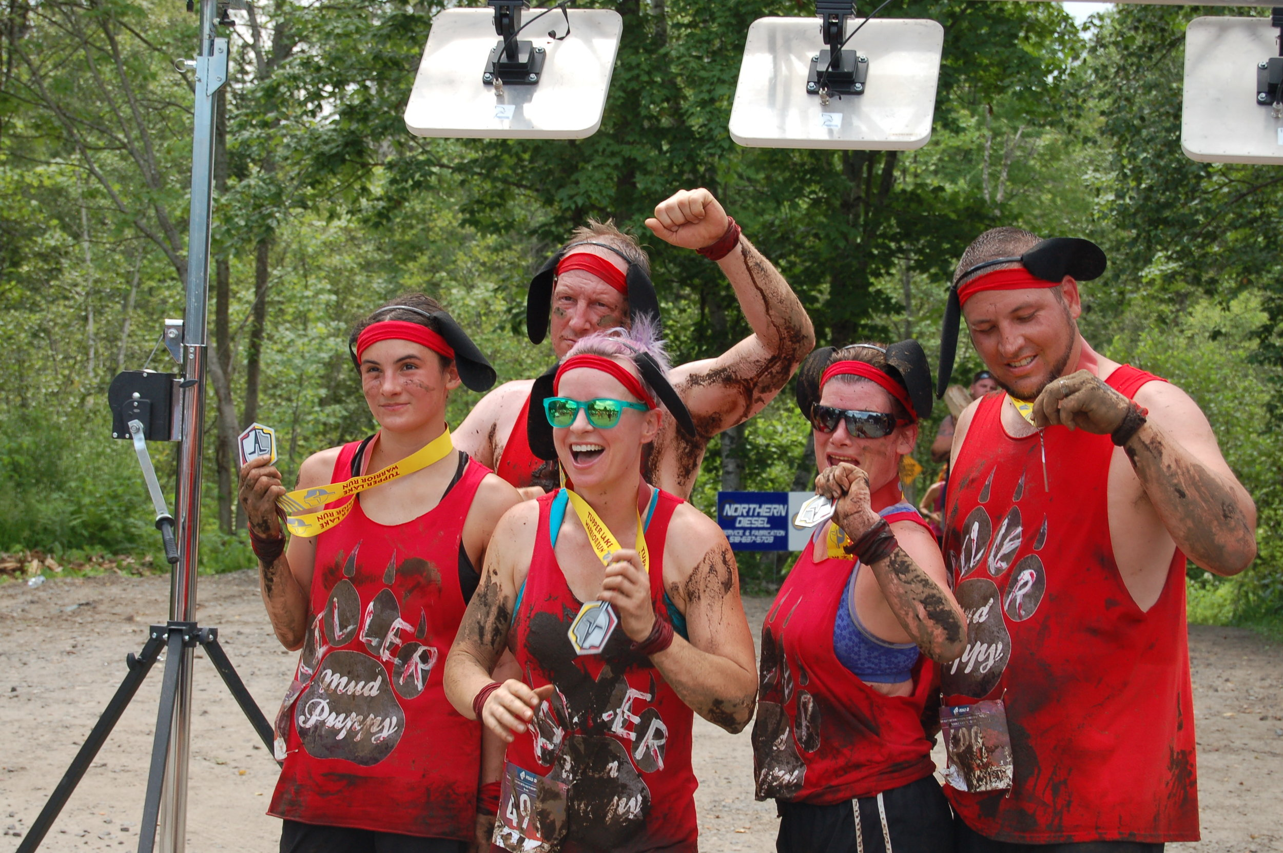 The Killer Mud Puppies show off their medals after the run.