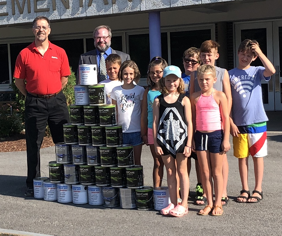 Paint to brighten school    Maurice Fortune of Fortune's Hardware and School Superintendent Seth McGowan were joined by Tupper Lake day campers last week to show off the 30 gallons of paint that will soon be applied to the interior of the L.P. Quinn Elementary School. The town day campers (not in order) who helped build this paint-can pyramid were Layne Locke, Olivia Chesbrough, Braydon Shannon, Sireea Zaidan, Lacy Pickering, Liam Kavanagh, Tucker Savage and Ashton Metz. (McClelland photo)