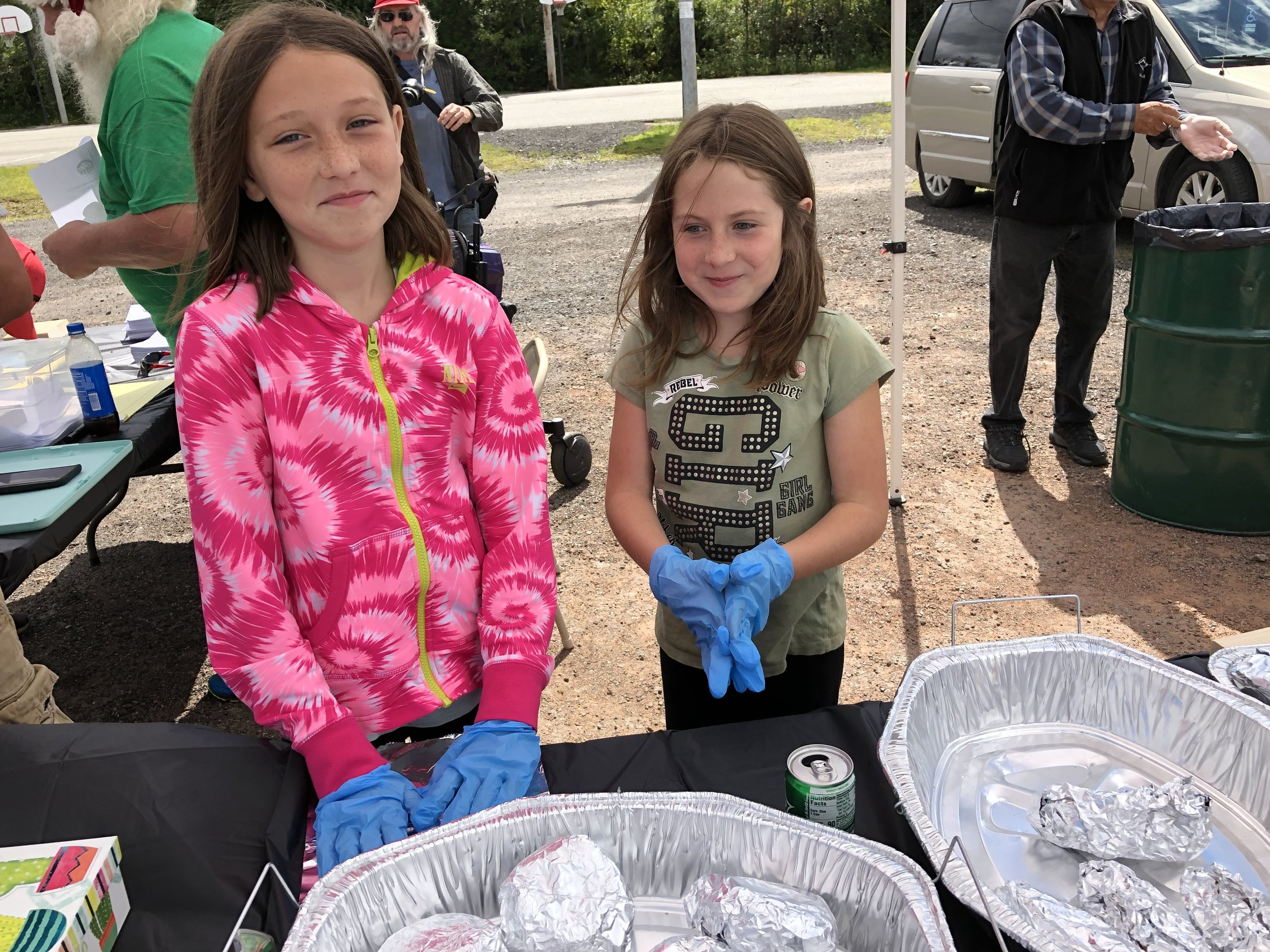 Brina Reandeau and Eliza Bujold, who are part of Tupper Lake's new New York Life family, were helping distribute freshly grilled hot dogs and hamburgers to voters Saturday.