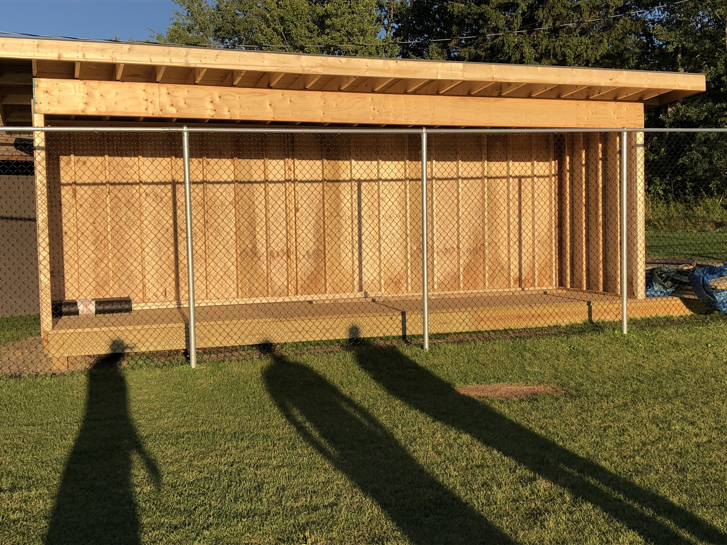 You are looking a brand new above-ground dug-out that volunteers of the Tupper Lake Youth Baseball and Softball Association erected in one day Saturday behind the backstop fence at the new Little League diamond in the Tupper Lake Municipal Park.