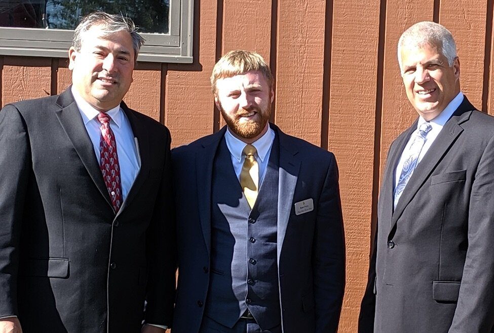 New Tupper Lake Funeral Director Ryan Frary (at left) poses with retiring partners Shawn Stuart and Brendan Keough outside the Cliff Ave. business recently.