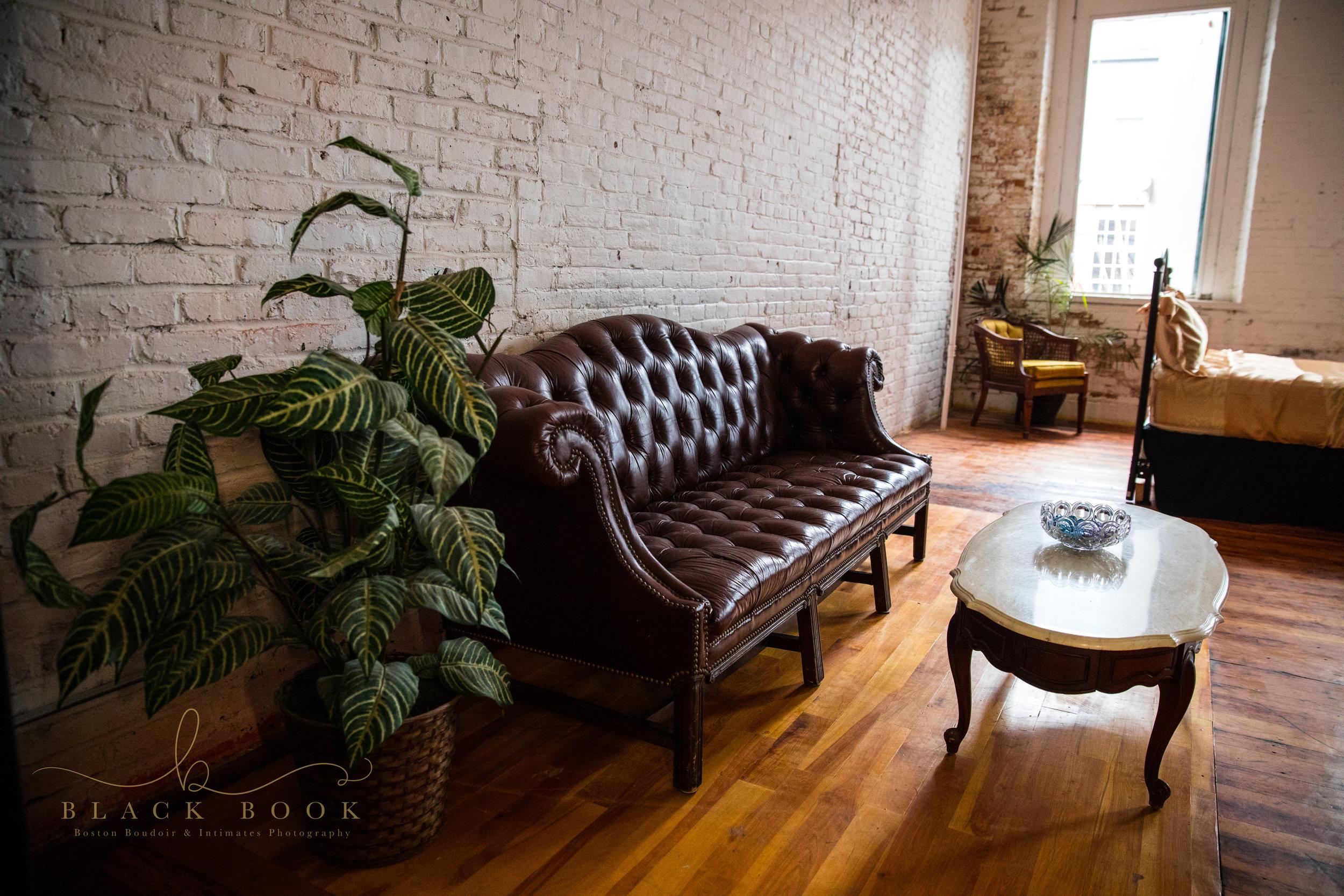 vintage-couch-brick-wall-boston-Boudoir-Studio-Amanda-Morgan.jpg