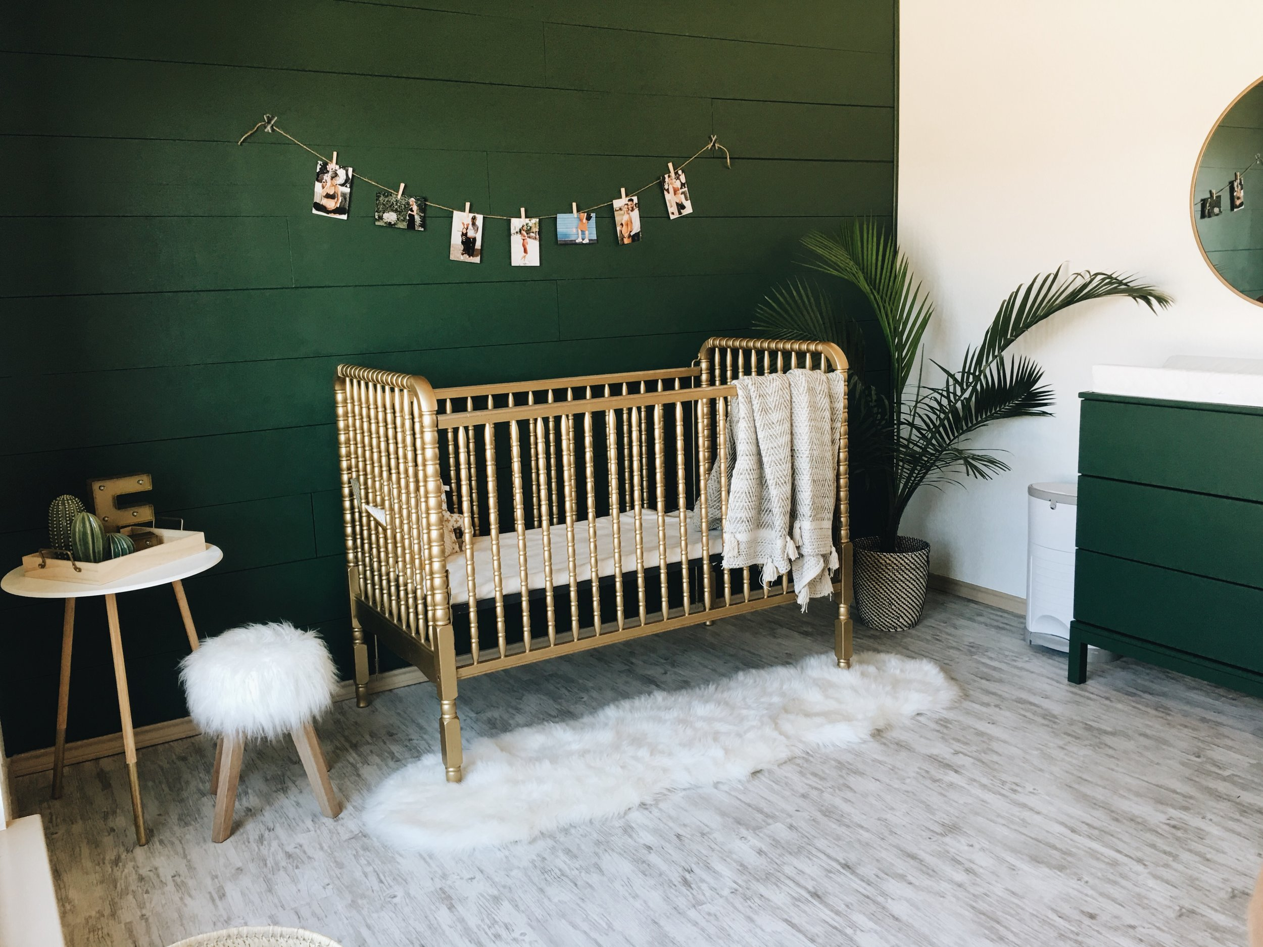Planked wall painted emerald green & gold painted crib