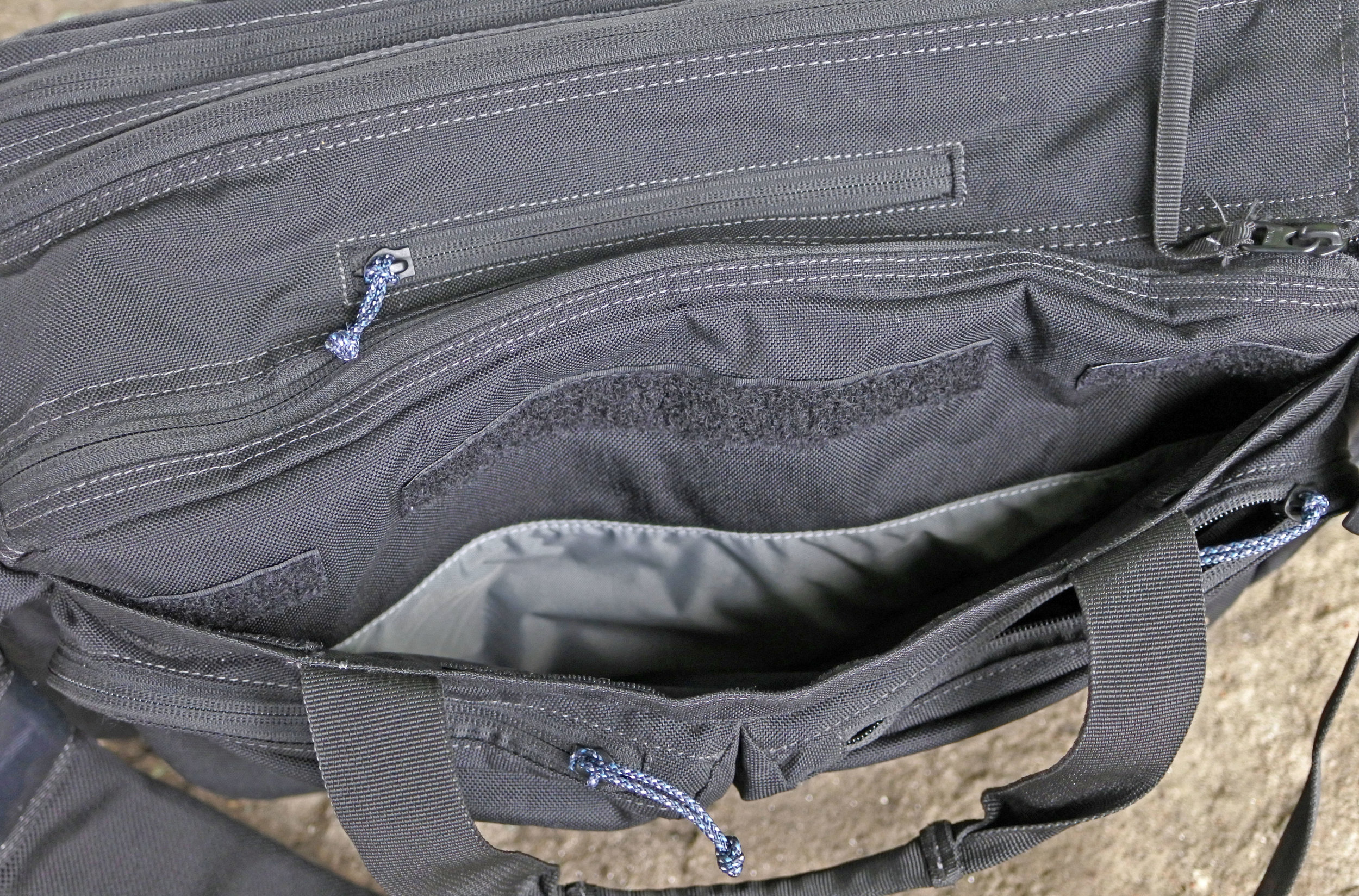 There is a hidden pocket on the front of the bag, under the admin pockets.