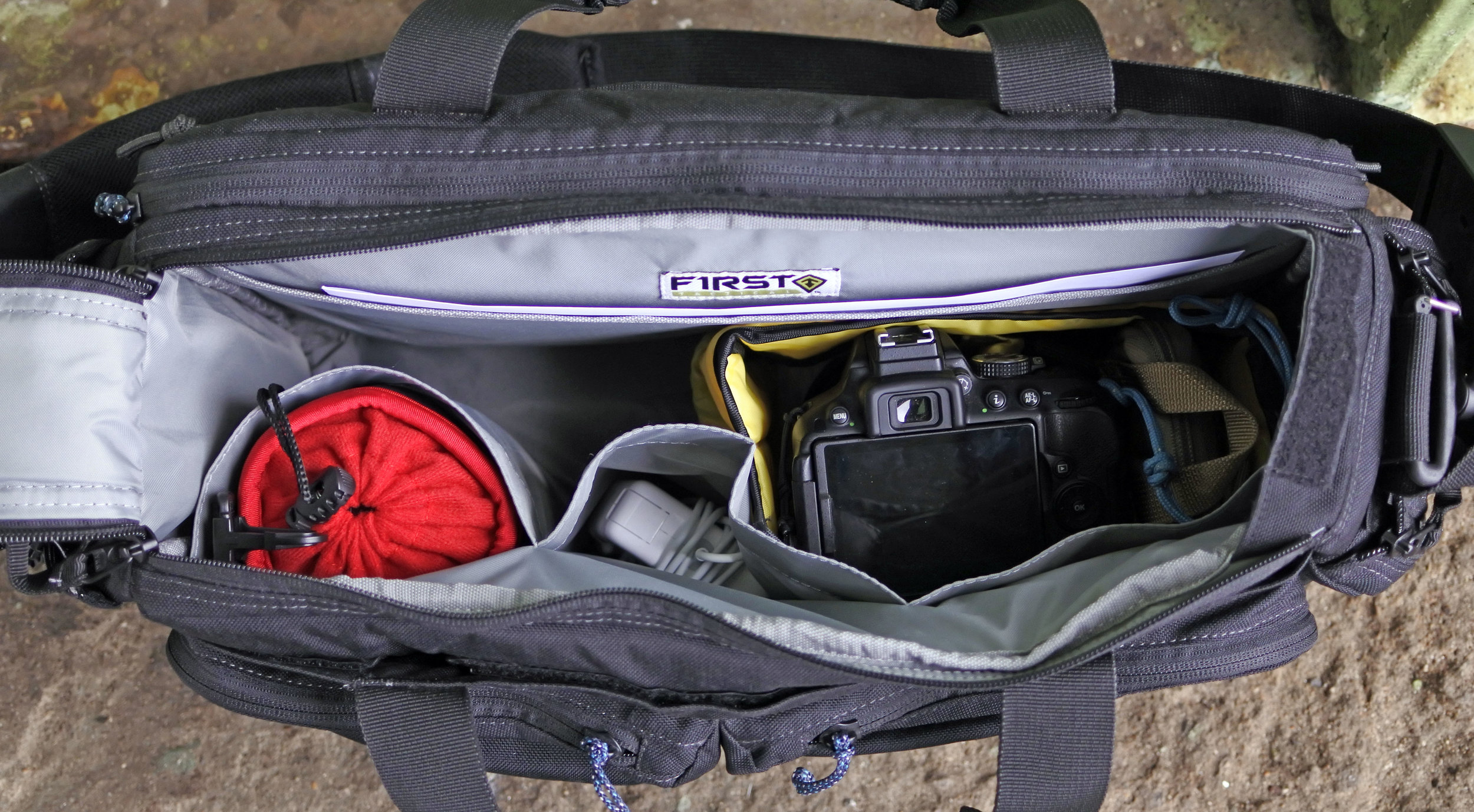 Looking into the bag from above. There are 3 open top pockets on the front wall and a document sized sleeve on the rear.