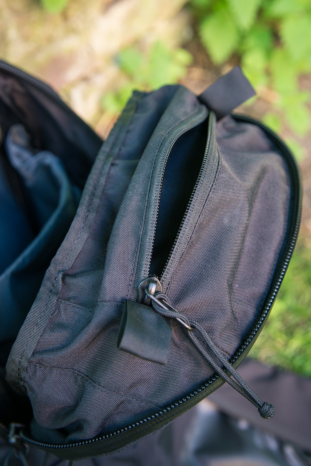 A little triangular pouch sits at the top under the main zipper - a great spot for a glasses case or compact camera.