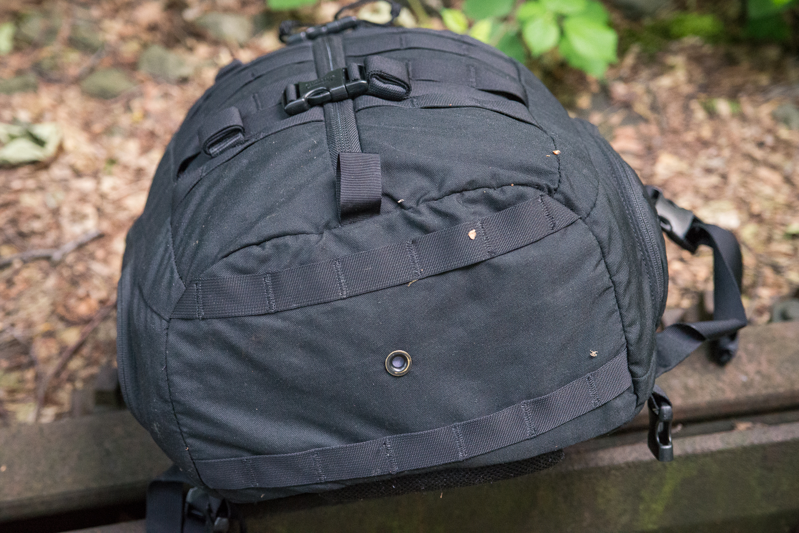 There are two rows of MOLLE across the bottom to accept things like the  Cache from OV Innovations. Yes, that is this pack in the OVI photos!
