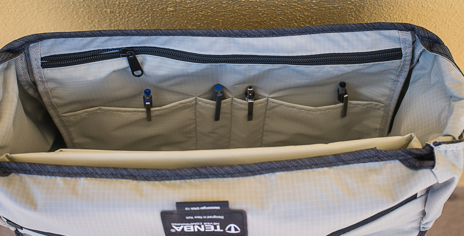 The zipper pocket in the front is a large slip pocket.