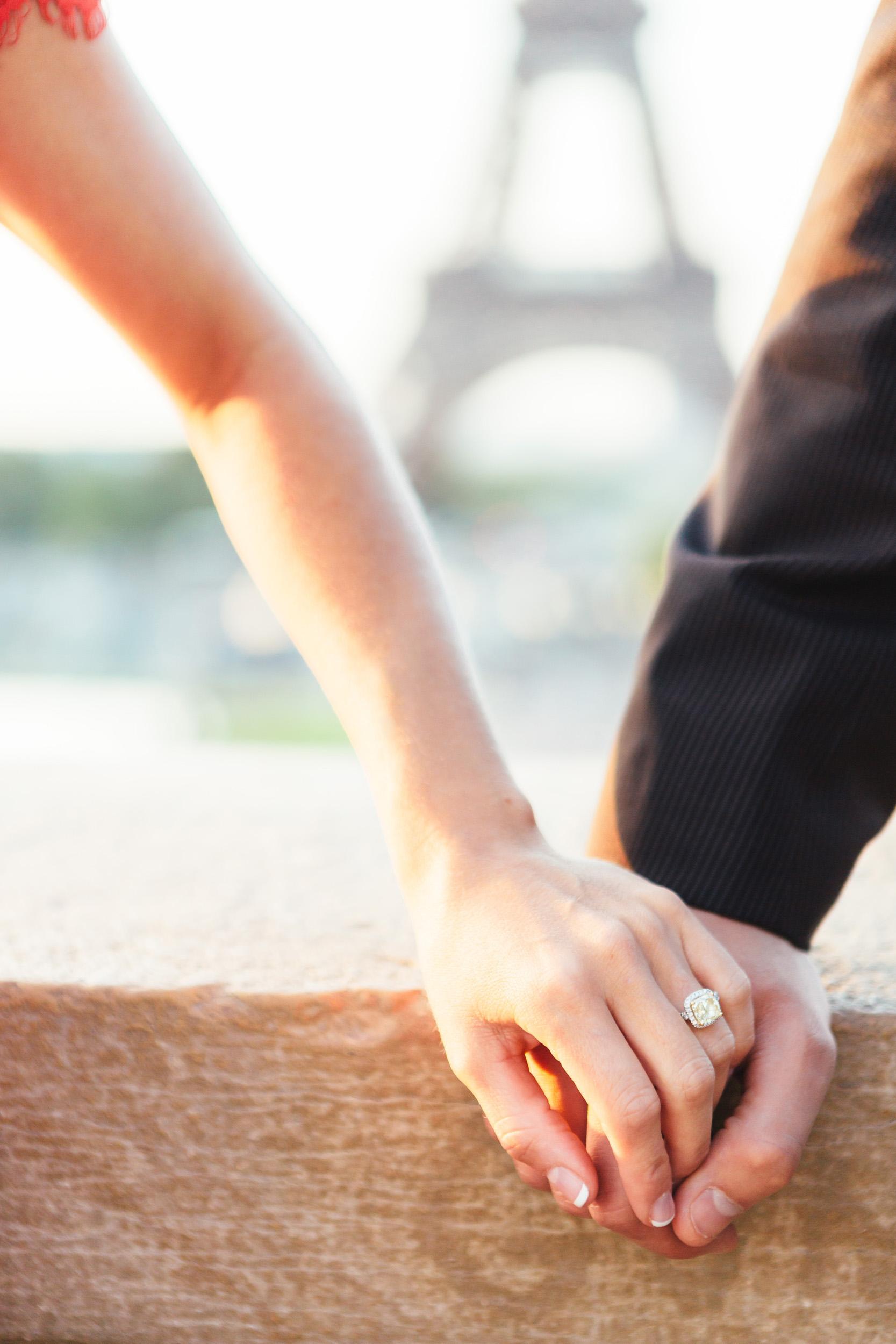 paris photographer engagement ring eiffel tower