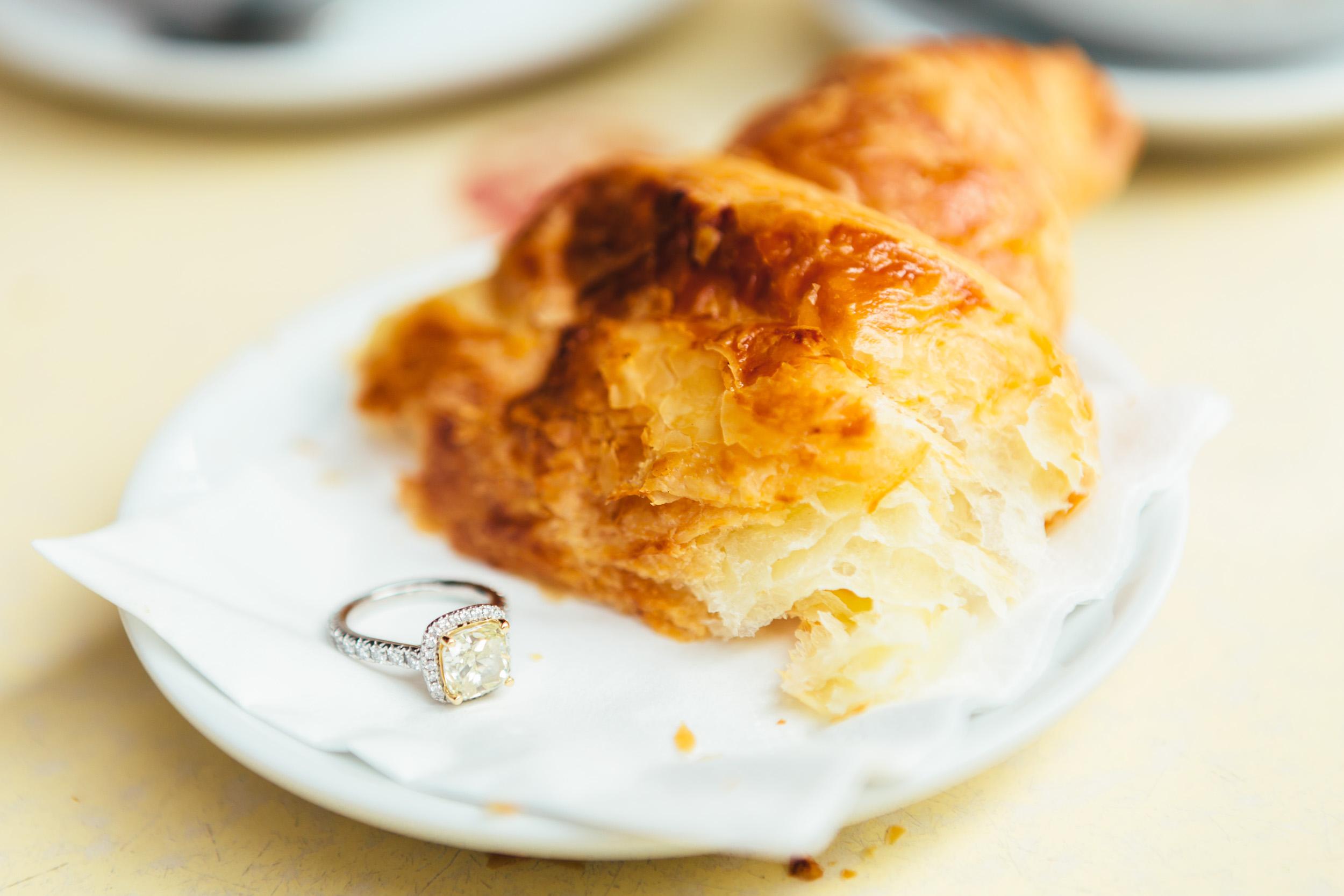 Paris photographer engagement ring cafe croissant