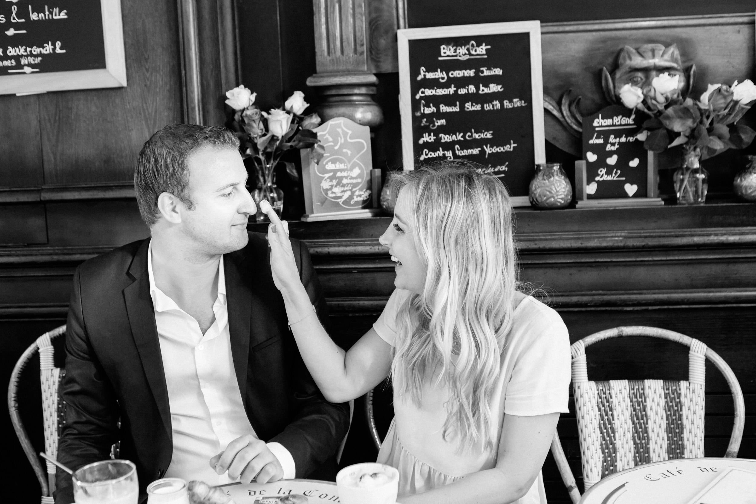 photographer in paris engagement ring café croissant