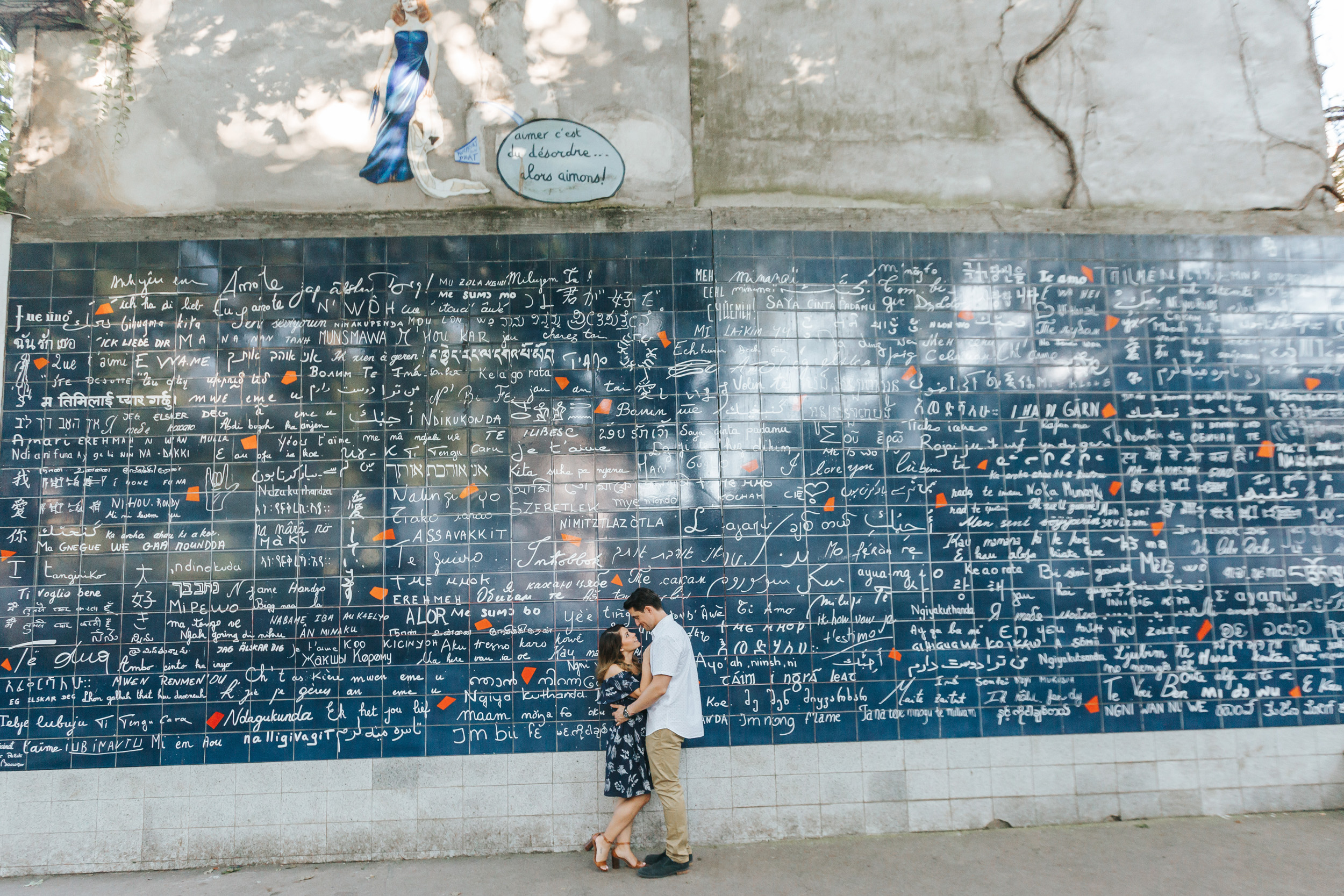 Paris Photographer   Couple Session   Love Story Montmartre Sunrise Flowers Anniversary Love Wall