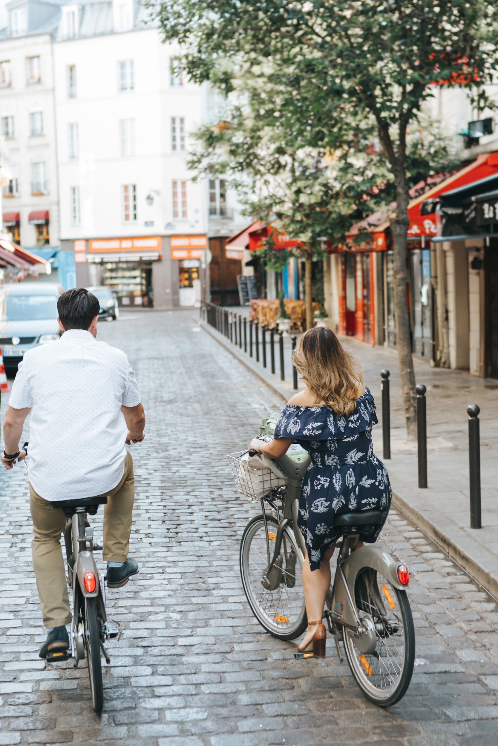 Paris Photographer   Couple Session   Love Story Notre Dame Sunrise Flowers Anniversary Velib bicycle