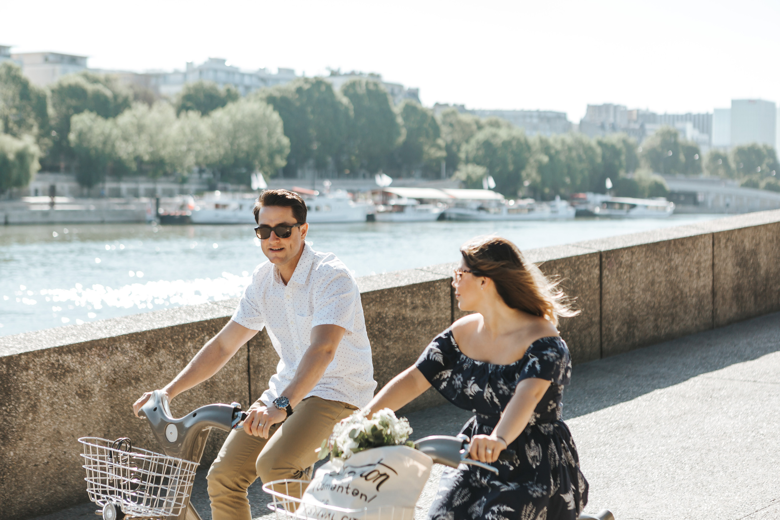 Photographer in Paris   Couple Session   Love Story Quai Seine Anniversary Velib bicycle