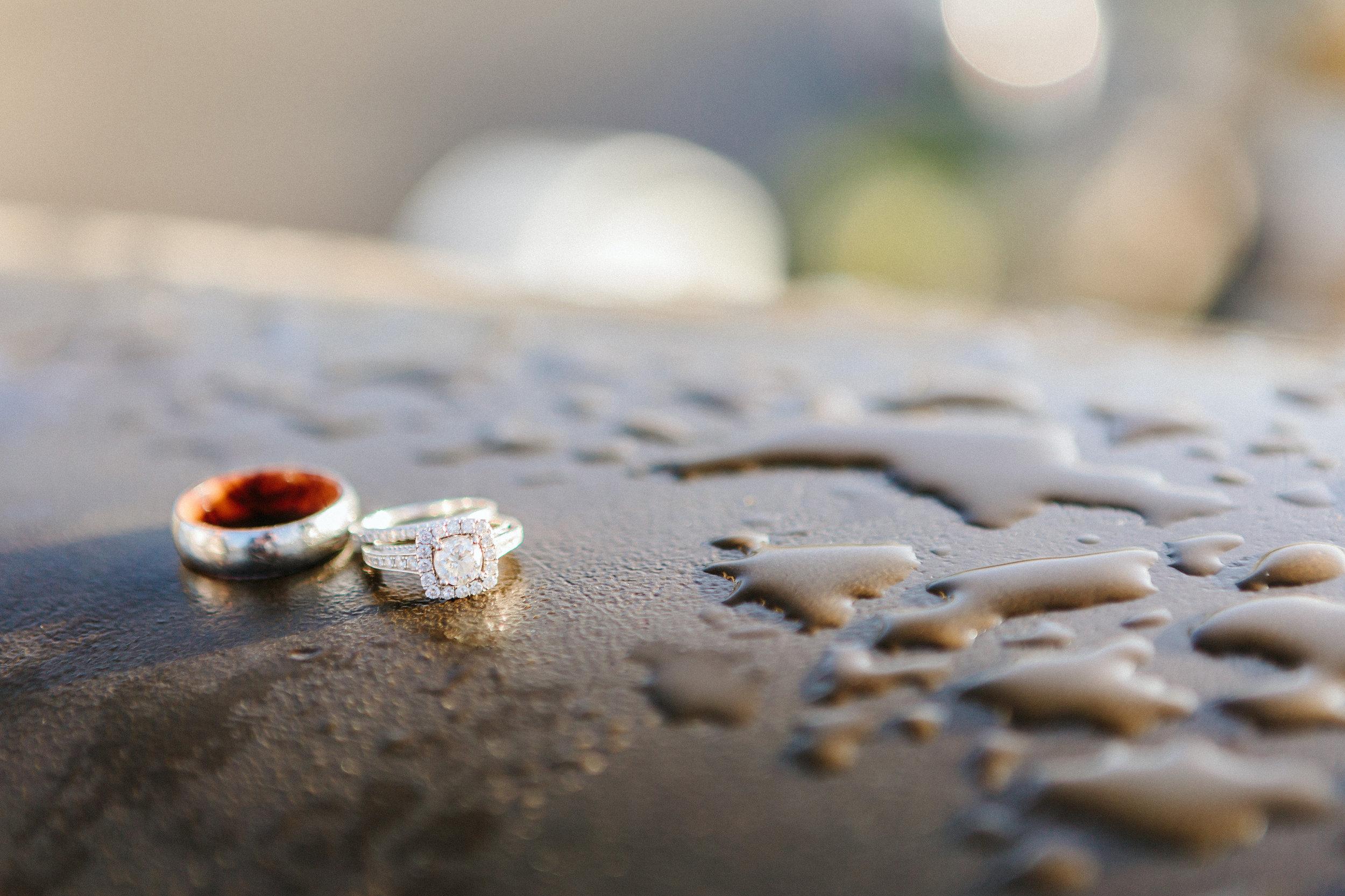 paris photographer engagement diamond ring detail in the rain on alexandre III bridge