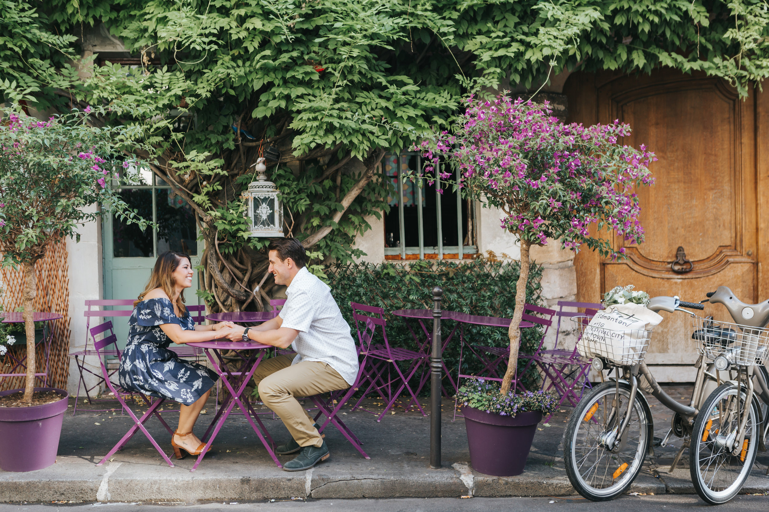 paris photographer anniversary couple session portrait at oldest cafe in paris