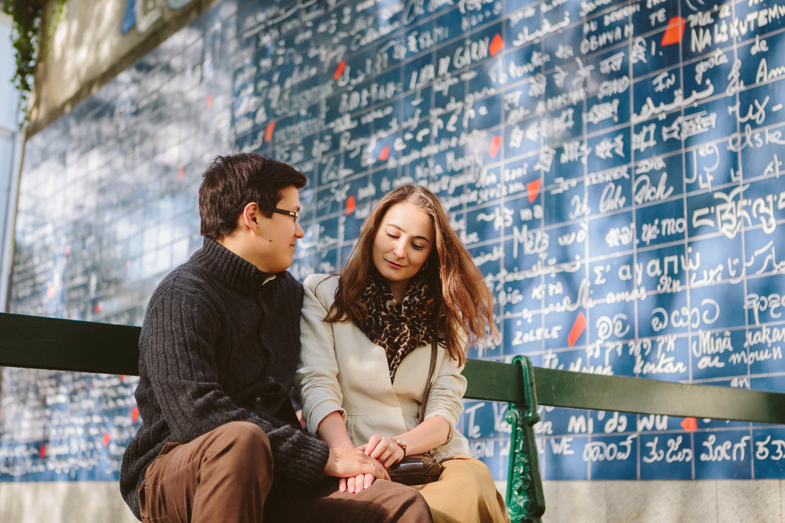 paris photographer engagement couple portrait by I love you wall Le mur des je t'aime in montmartre