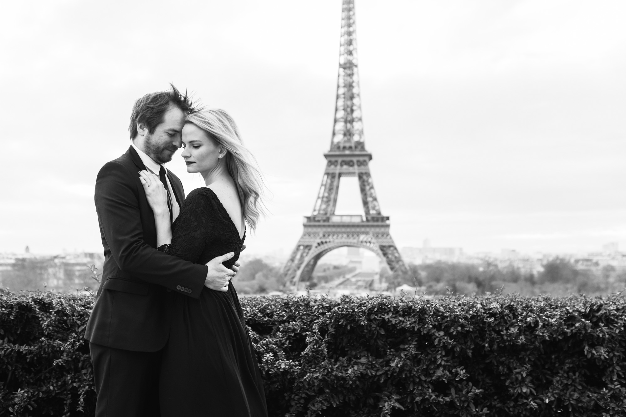 Paris engagement couple portrait in black and white by the Eiffel Tower captured by Paris Photographer Federico Guendel