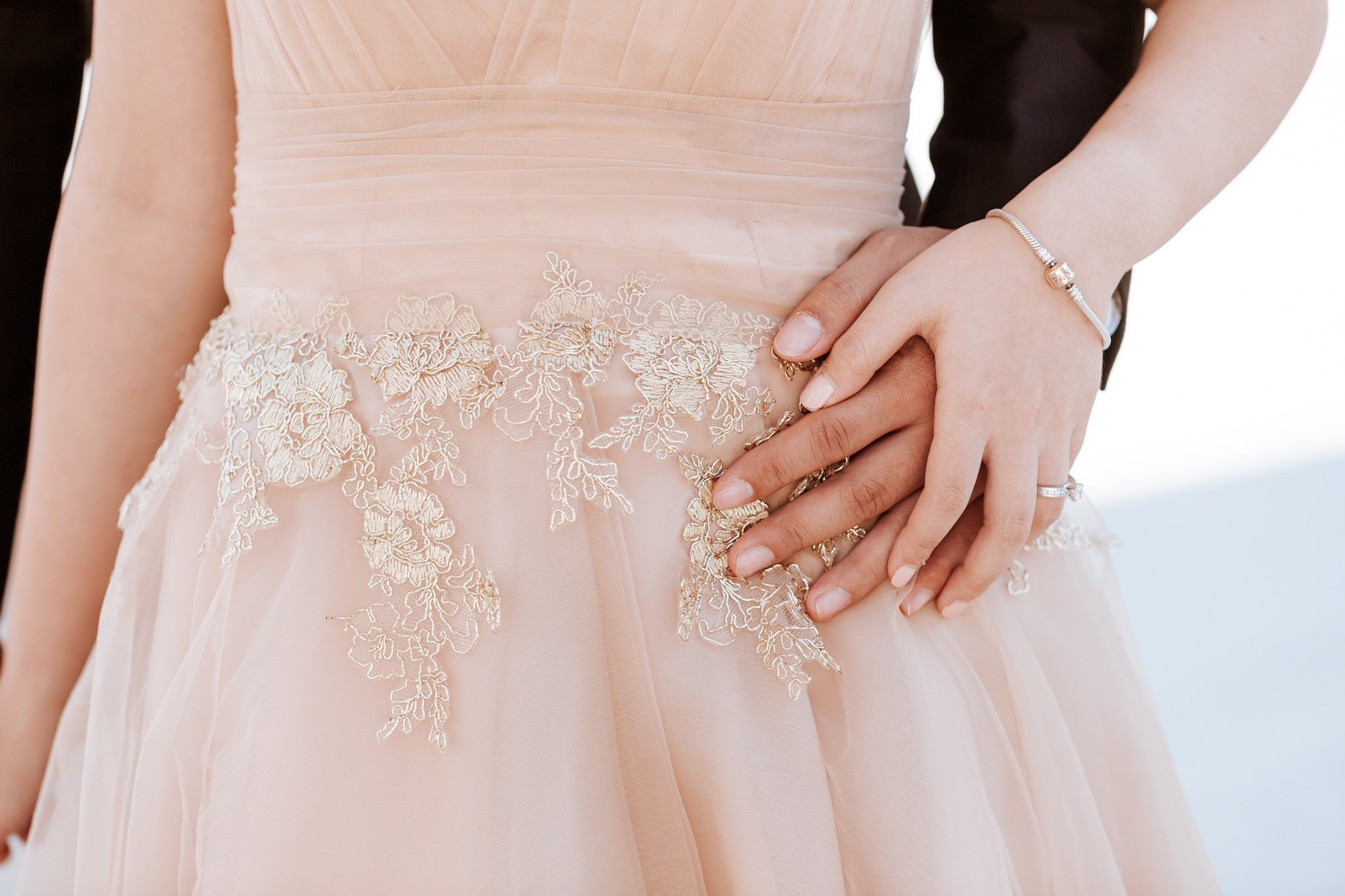 Pre-wedding couple photo session holding hands by the details of the dress captured by Paris Photographer Federico Guendel