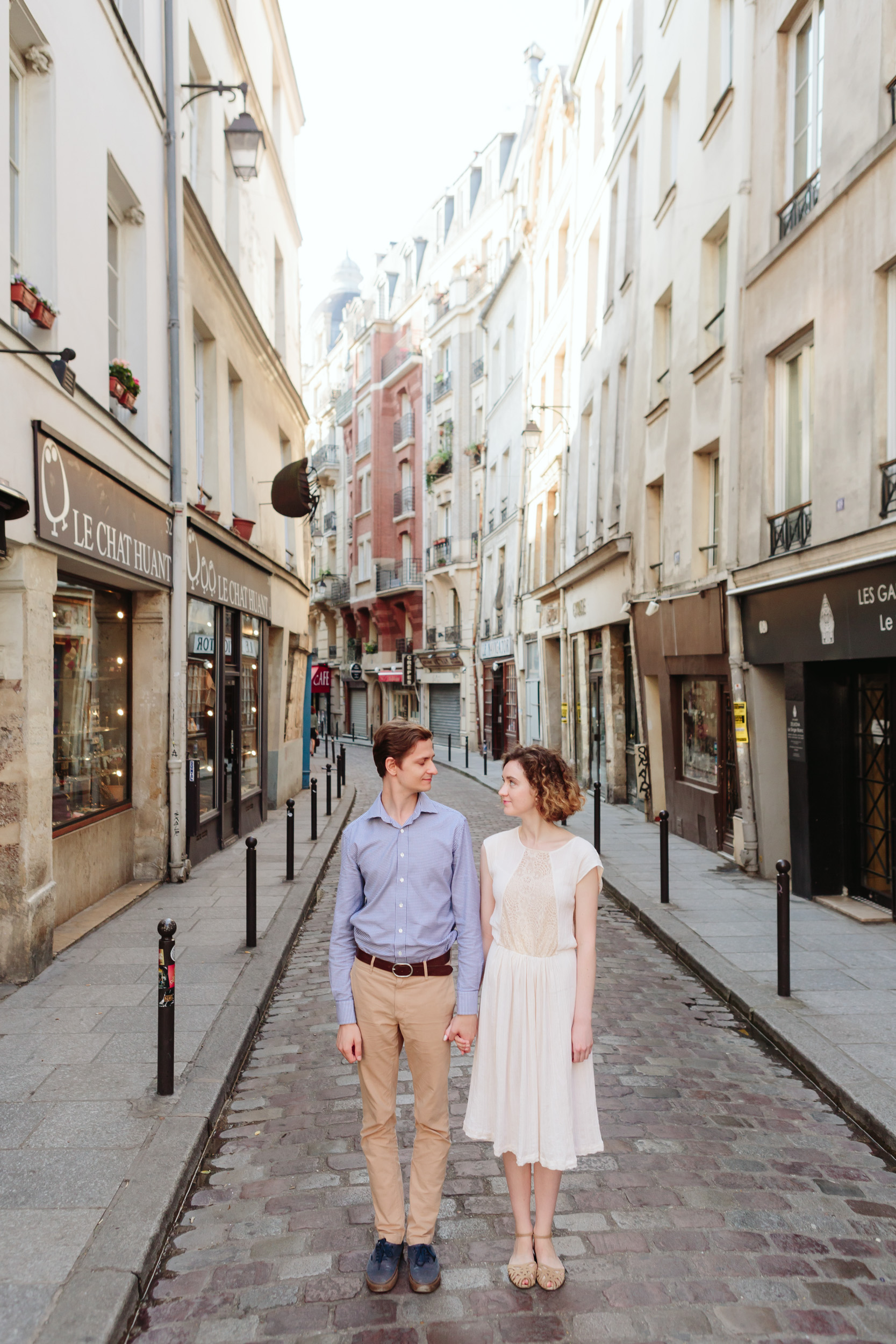 Couple in love standing the streets of Saint Germain in Paris captured by Paris Photographer Federico Guendel IheartParisFr