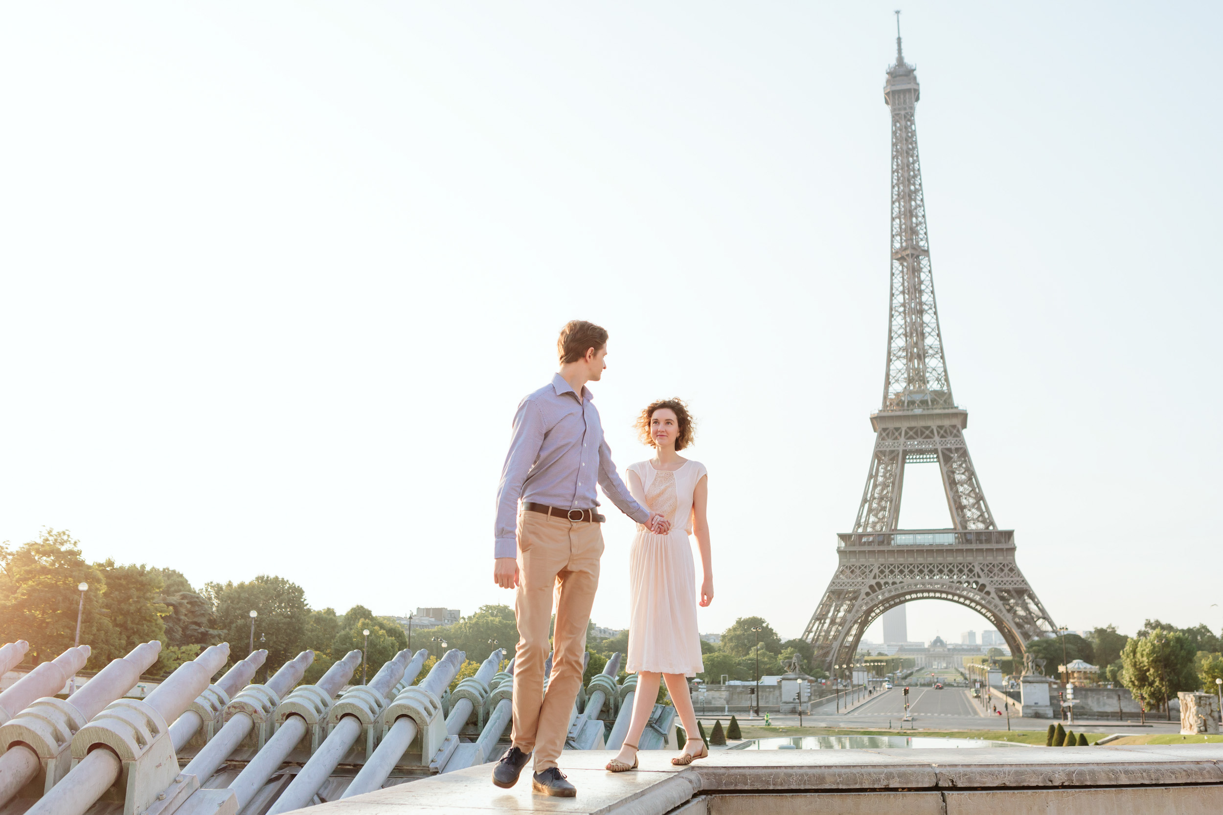 Couple in love walking at Trocadero by the Eiffel Tower captured by Paris Photographer Federico Guendel IheartParisFr