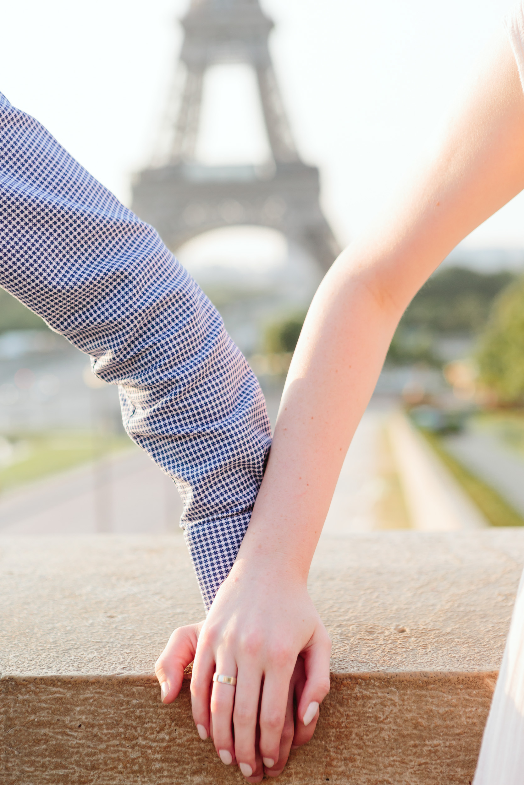 Holding hands next to the Eiffel Tower captured by Paris Photographer Federico Guendel IheartParisFr