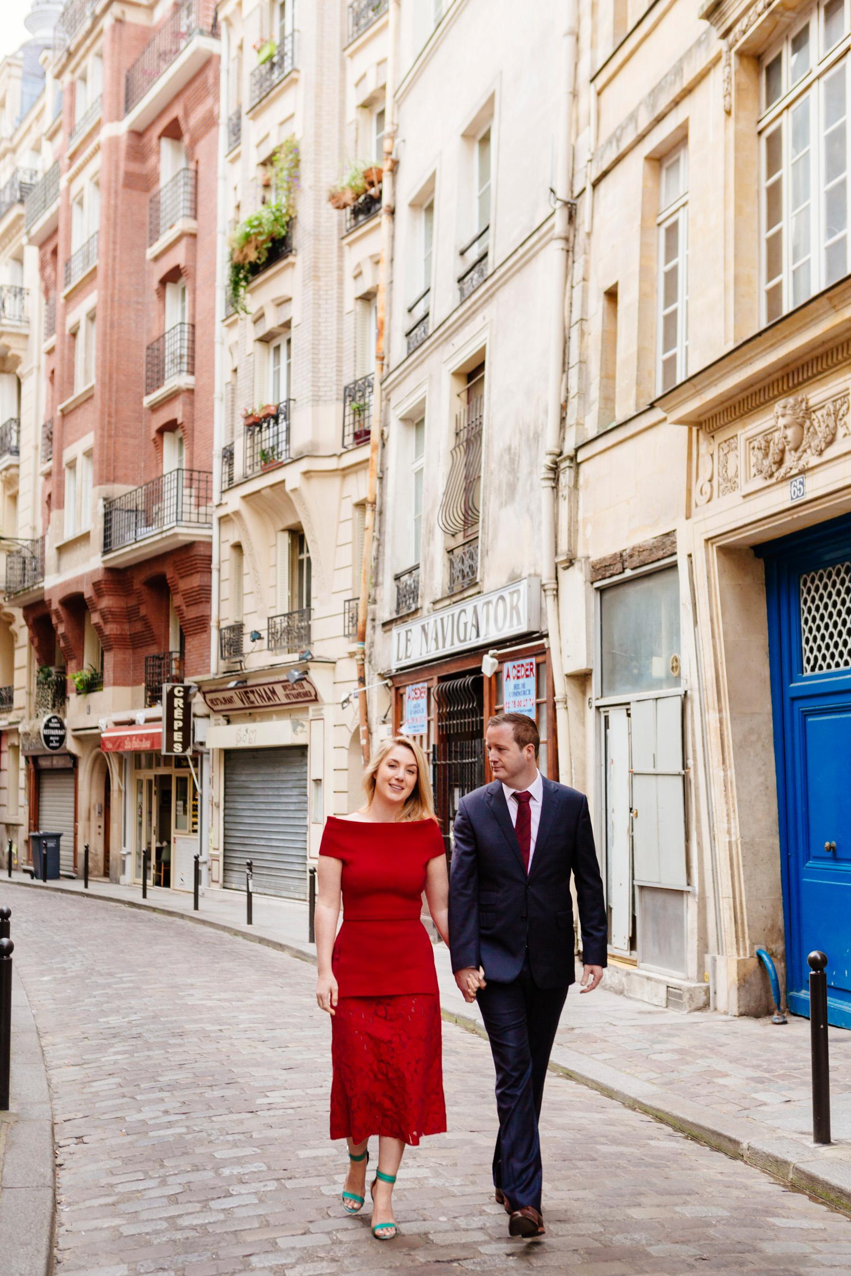 Romantic portrait of a couple walking through a typical Parisian street in Saint Germain captured by Paris Photographer Federico Guendel www.iheartparis.fr