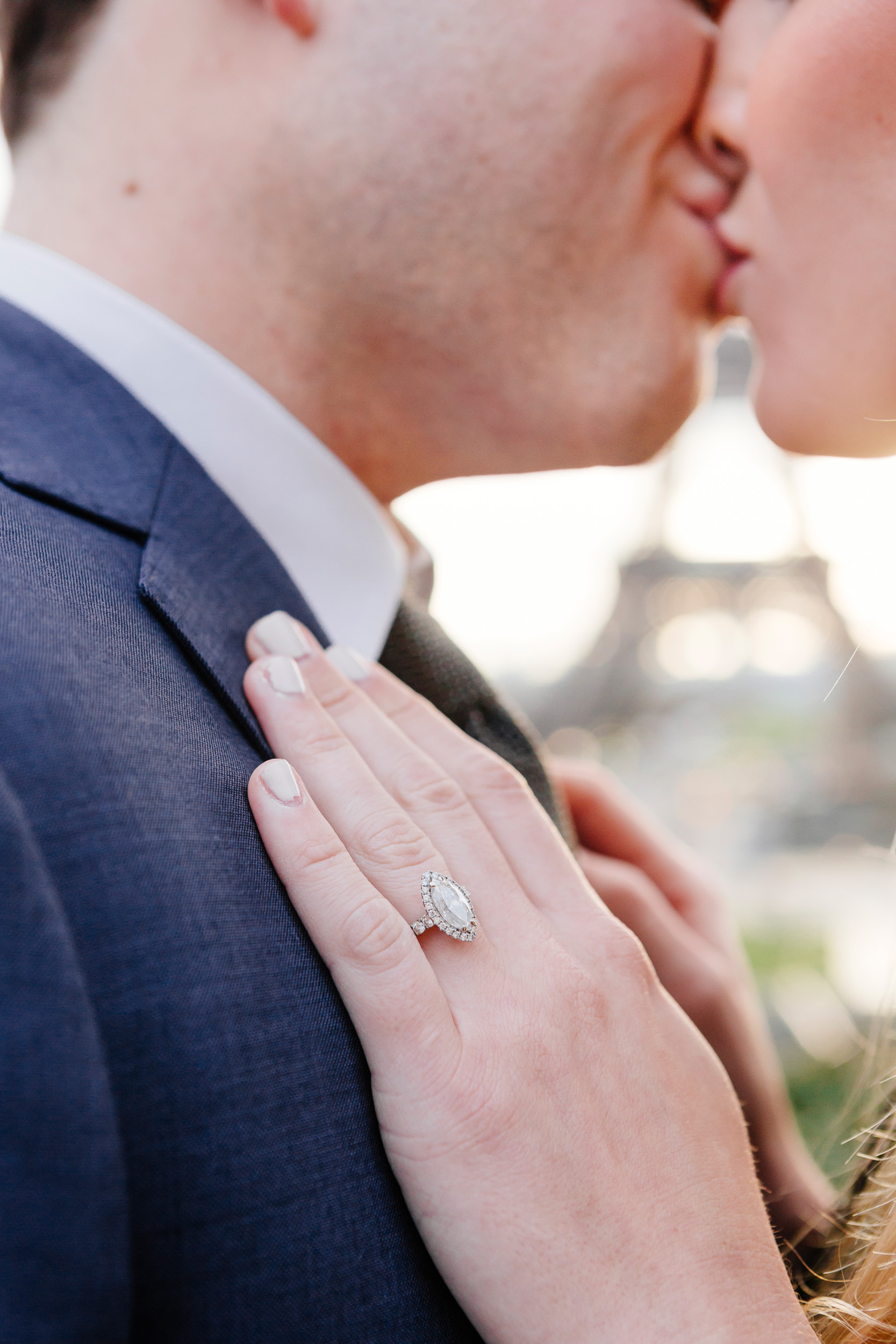 Close up of diamond engagement ring detail with the view of Eiffel Tower captured by Paris Photographer Federico Guendel www.iheartparis.fr