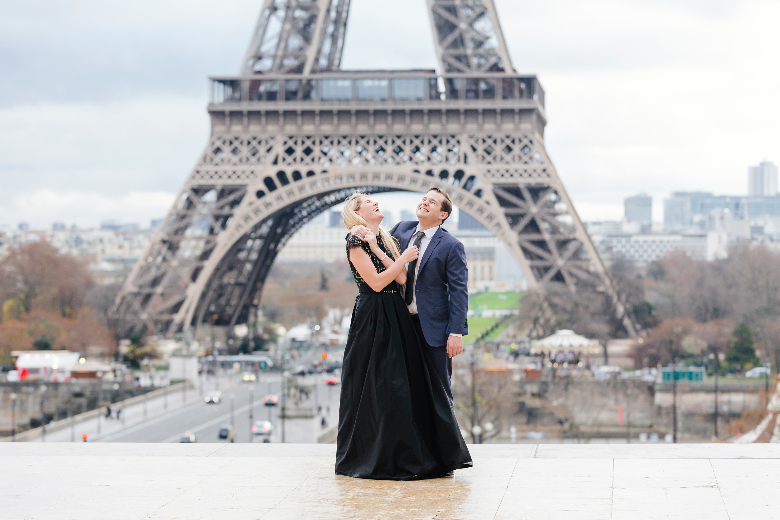 Paris vacation romantic couple portrait laughing happy at Trocadero with the view of Eiffel Tower captured by Paris Photographer Federico Guendel www.iheartparis.fr