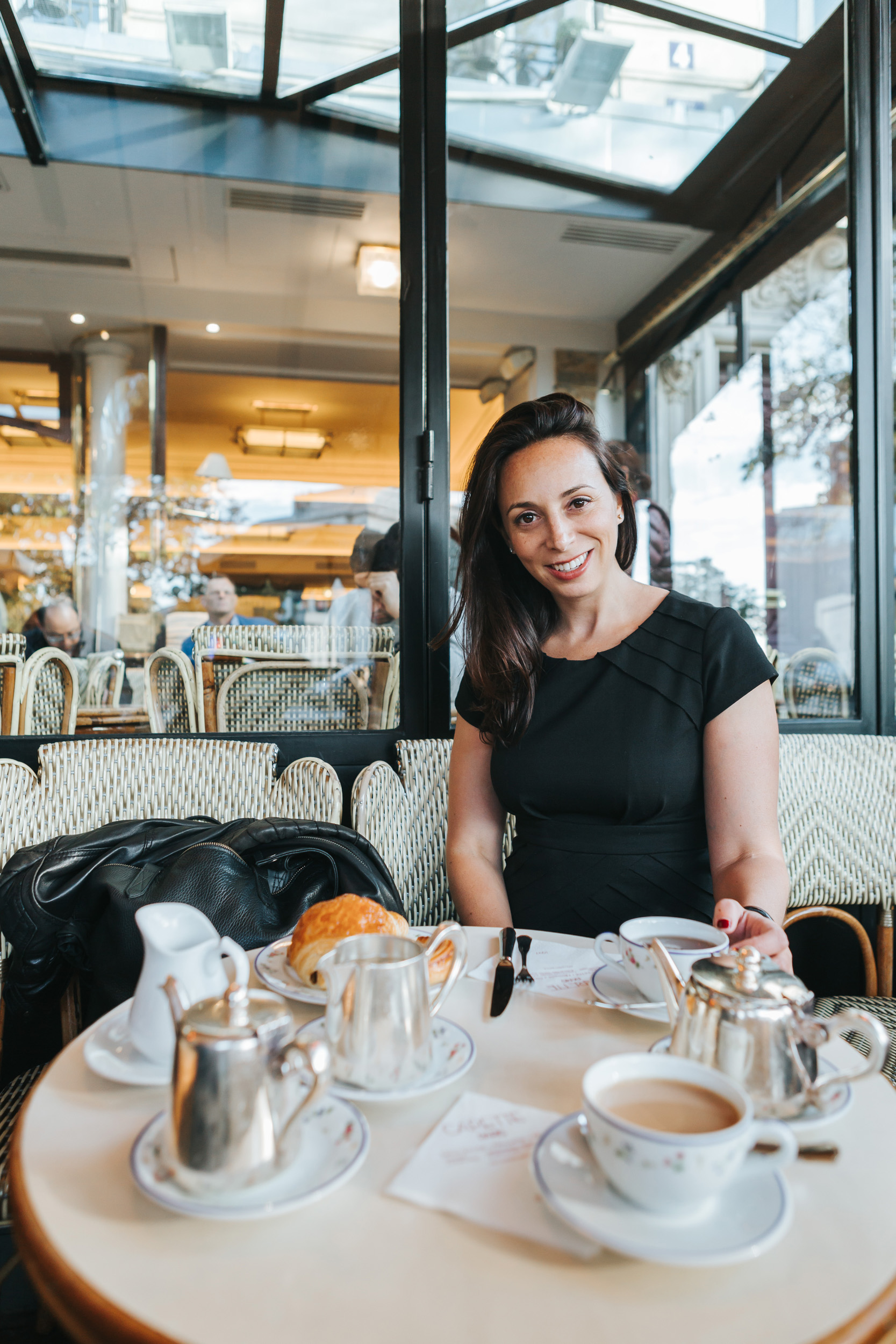 Portrait of Rebecca Plotnick founder of Every Day Parisian blog at cafe Carette captured by Paris Photographer Federico and Anastasia Guendel IheartParisFr TheFlyingPoodle