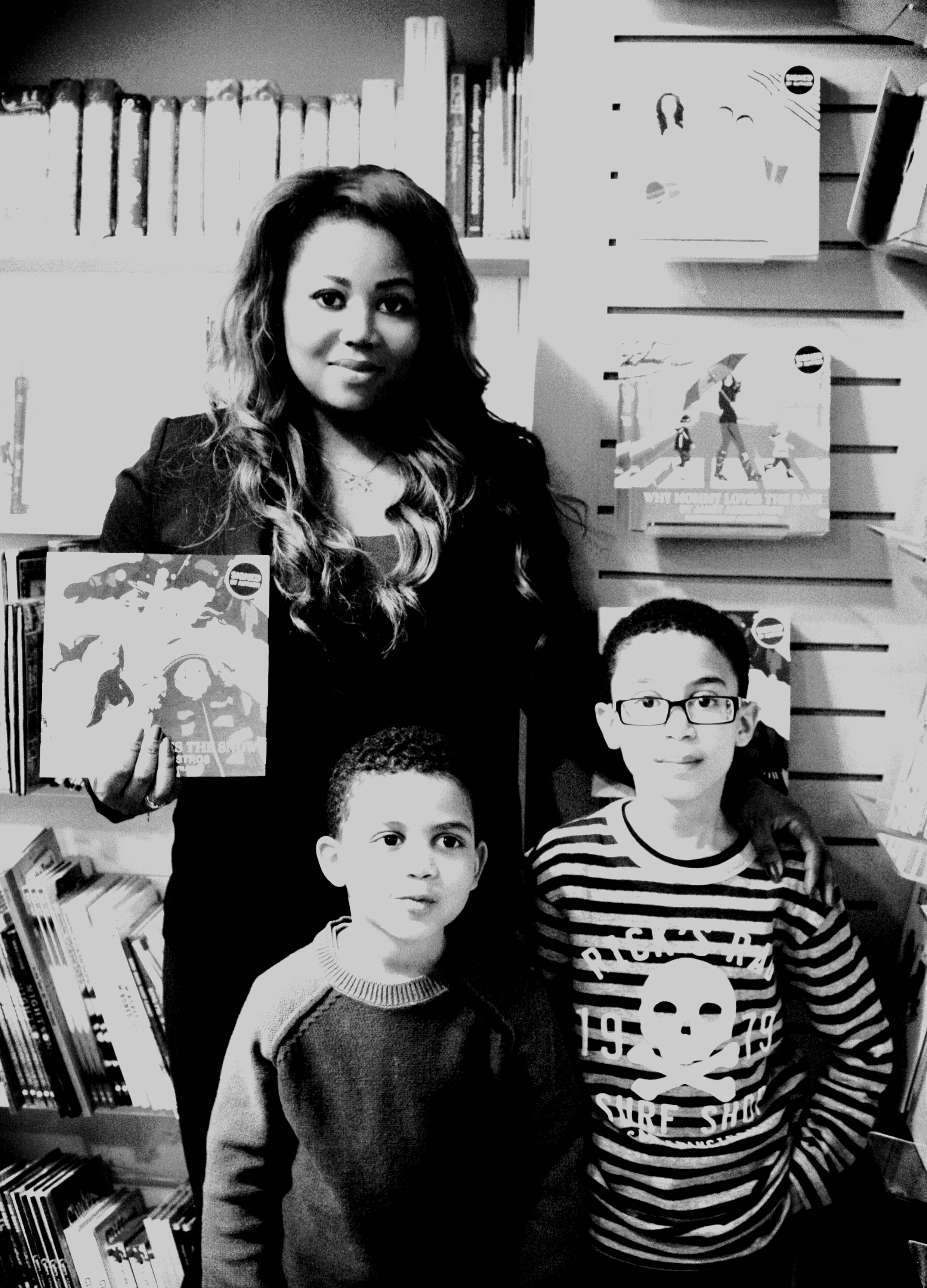 Pictures with the books Janet Langston and Aaron.jpg