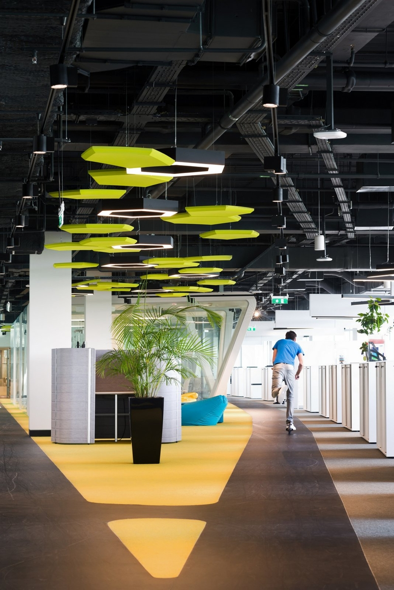 Scooter tracks on each floor in Adidas' Moscow office reflect the company's active lifestyle focus and encourage employees to move throughout the space.    Photo from Office Snapshots .