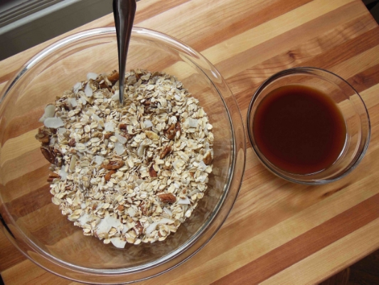 Oat mixture & maple syrup mixture combine for low-fodmap granola goodness.