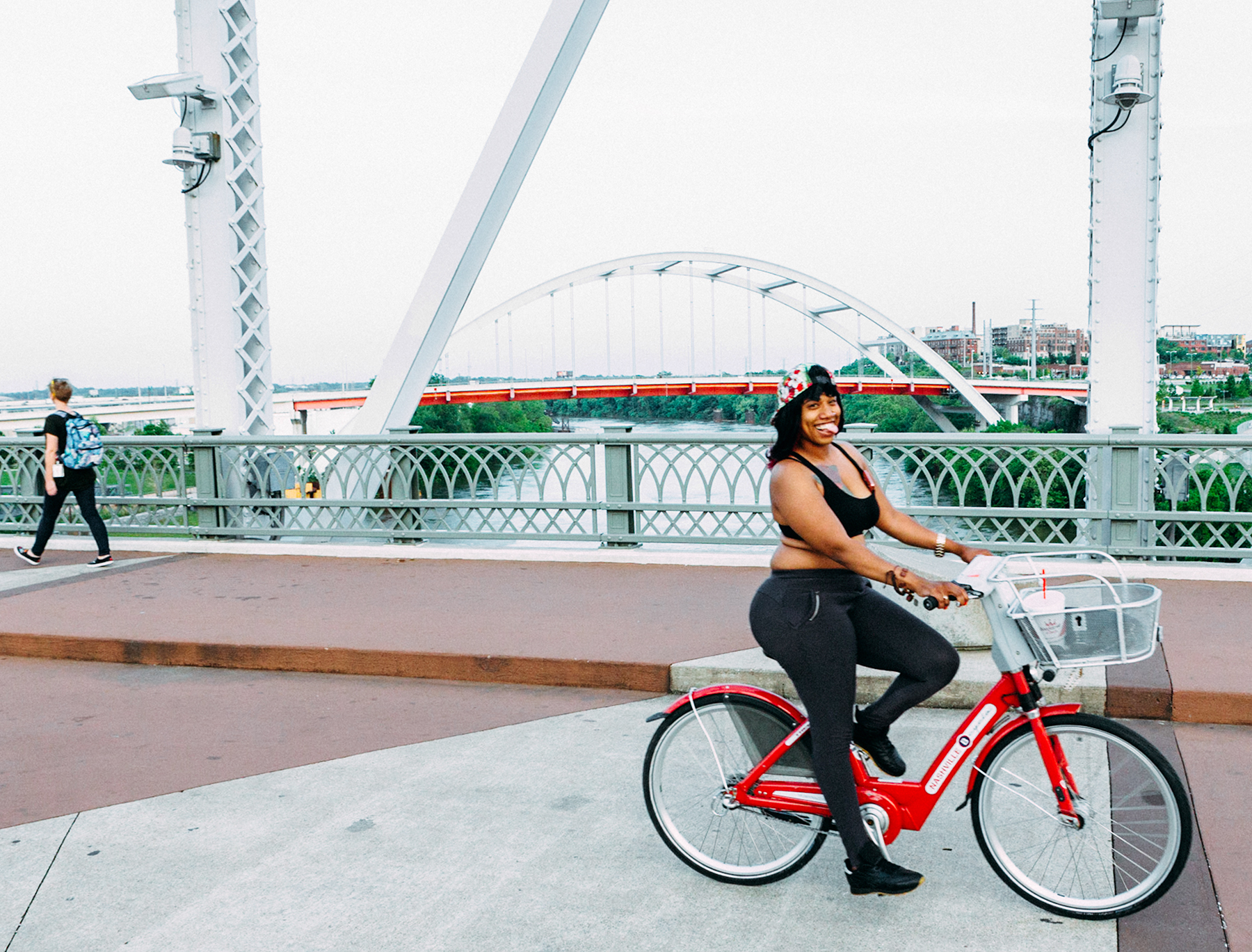 """Heidi prefers to let the photos here speak for themselves. However, she did have a story to share about this one, which was taken as she walked over the John Seigenthaler Bridge after a memorable shoot at the Schermerhorn Symphony Center. """"The woman on the red bike was shot the same day I shot Yo Yo Ma, as I walked back back over the bridge. It's the one I wanted to end the book with. The editor chose to end with a photo of the club, The End, which is fun and made sense. But the woman on the bike will always be the last page to me. She rode past me twice, the second time more slowly, laughing, and shouting, 'You can shoot me for your portfolio!'"""""""
