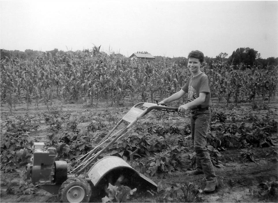 Sam tilling the gardenbw.jpg