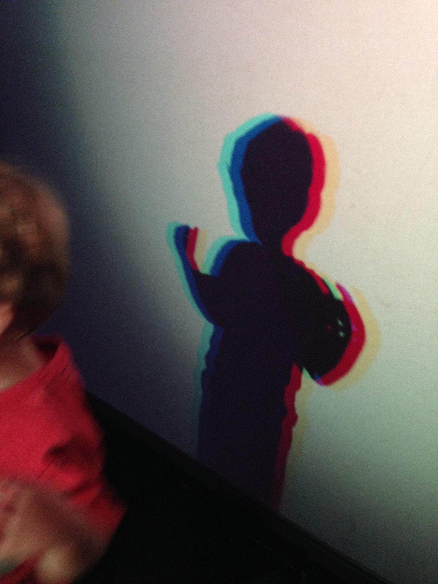 Sawyer playing in the light room at the Thinkery
