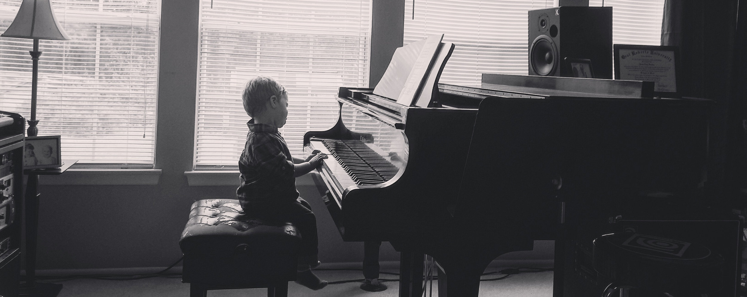Sawyer loved playing the grand piano at Pawpa's during Thanksgiving!