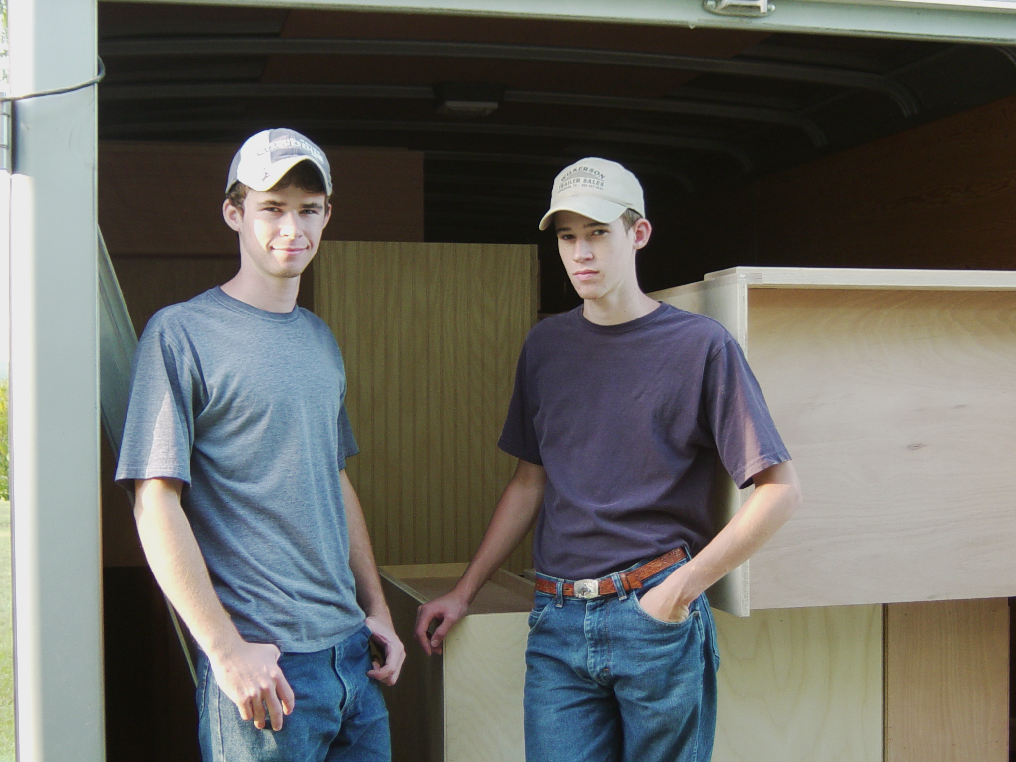 My brother James and I getting ready to set cabinets sometime in 2003.