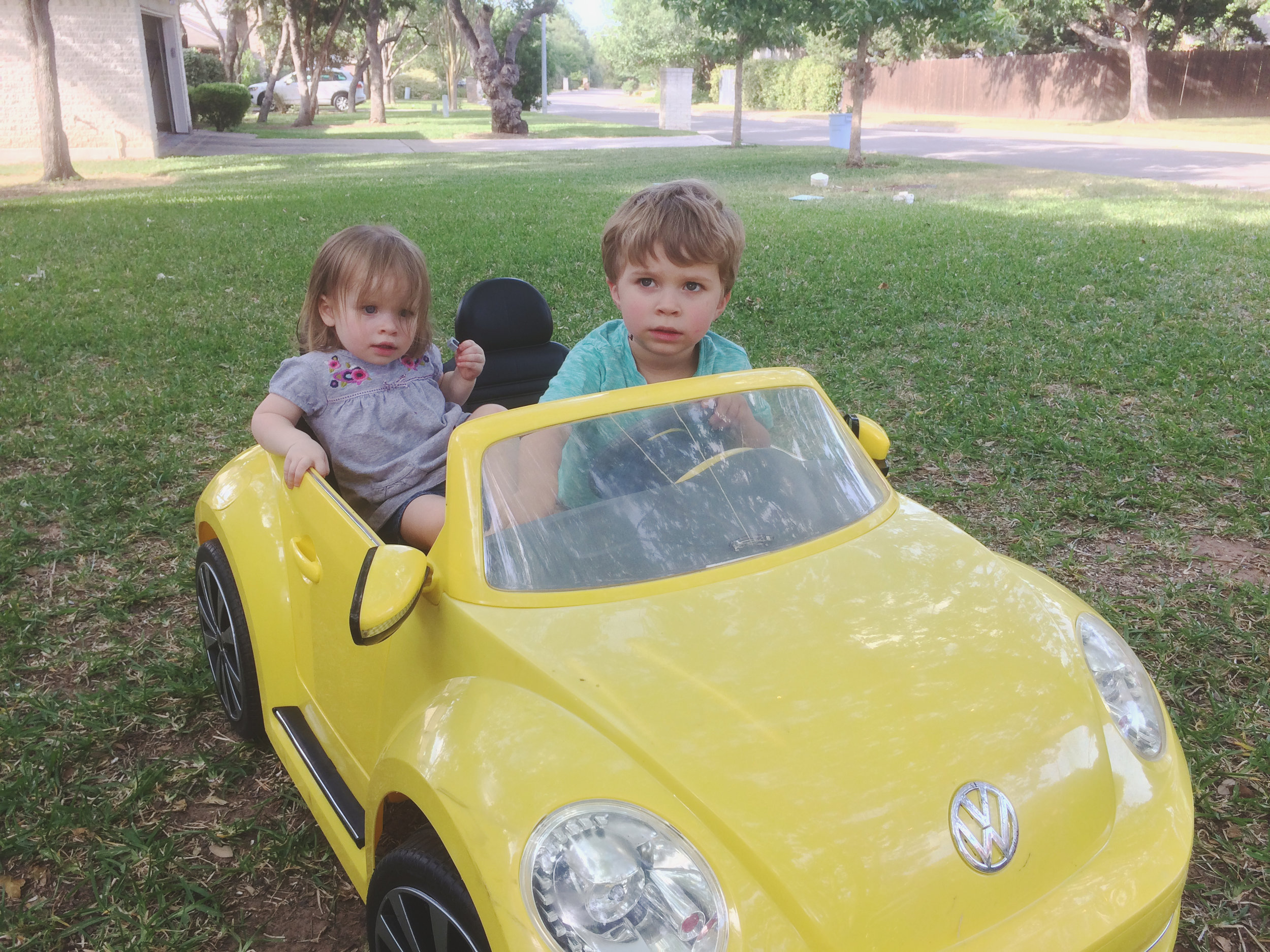 Sawyer and Jahnabell talking the neighbor's car for a spin. (please stop growing up so fast!)
