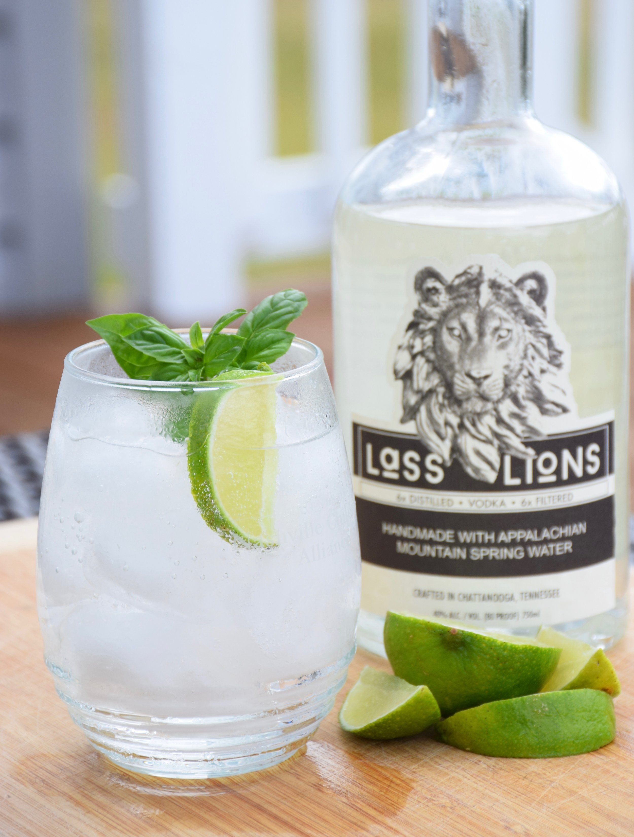 Summer Mineral - Ingredients:·1.5 oz Lass & Lions craft vodka·4 oz. sparkling mineral water·sliced lime squeezedCraft:Use a lowball glass and fill partly with ice. Combine ingredients in glass and stir. Garnish with sliced lime and mint.