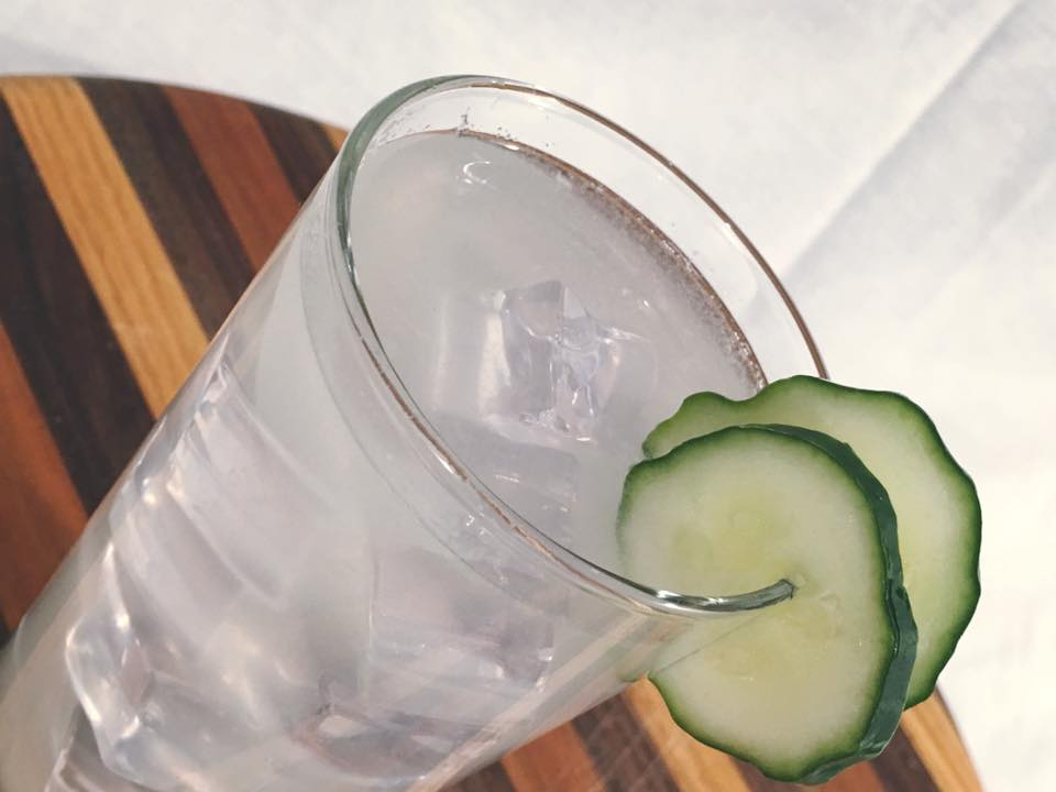 Relax - Ingredients:-    1.5 oz. Lass & Lions Unwind Vodka-   1/3-1/2 fresh cucumber peeled-  1.5 oz. simple syrup-    Juice from 1/2 fresh lime-    Club sodaCraft:Use a highball or Collins glass. Fill shaker with ice and combine all ingredients except soda. Shake and strain into Collins glass with fresh ice. Top with club soda.Garnish with cucumber slice.