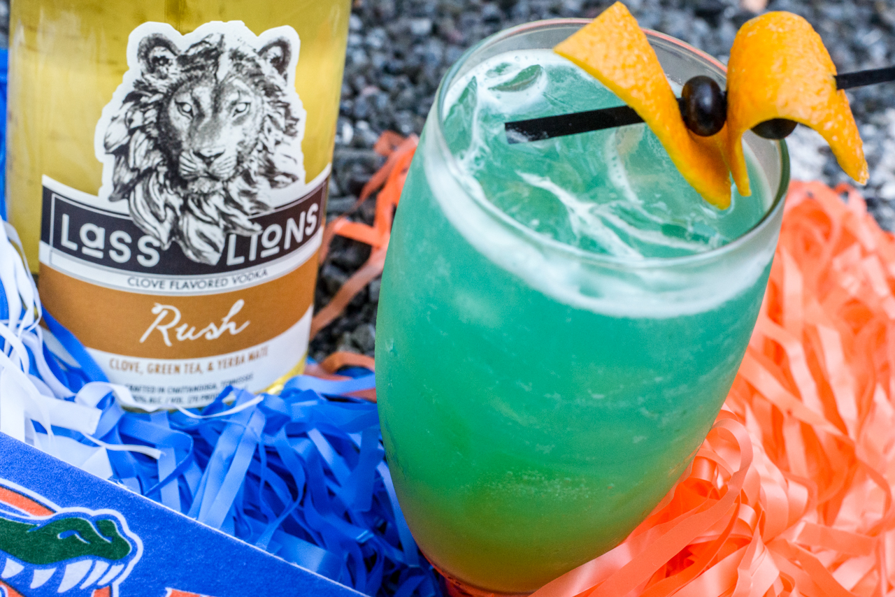 Swamp Runner - For all you Florida fans!Ingredients:2 oz. Lass & Lions Rush Vodka1/2 oz. banana liqueur1/2 oz. blue curaçao1 oz. pineapple juice1/2 oz. lime juiceOrange JuiceCraft:Add all ingredients in shaker, fill with ice, and shake. Strain into glass, fill with ice, and top with orange juice. Garnish with orange peels and blueberries.