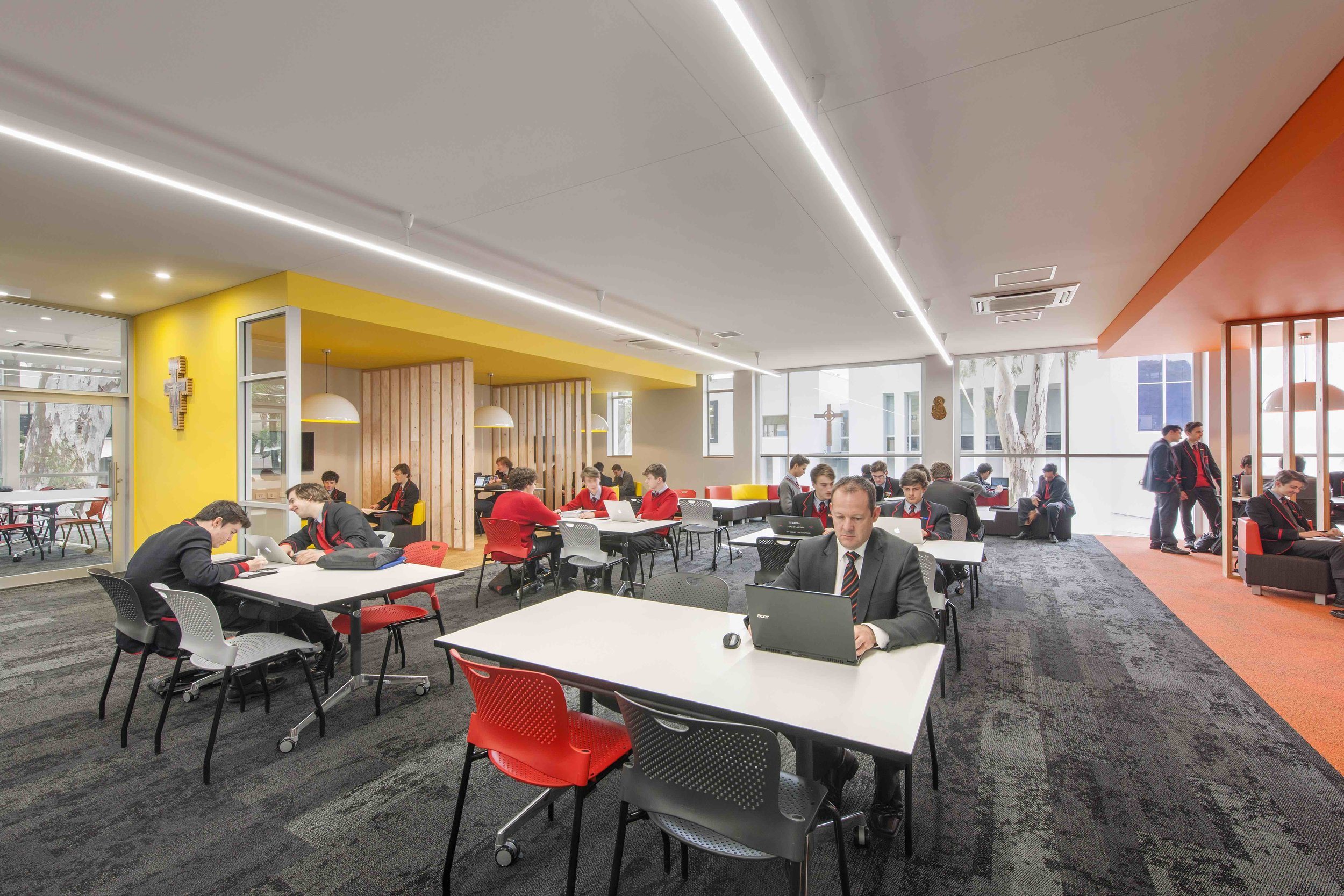Rostrevor College   Library + Classroom Refurbishment   Services: BESTEC Contractor: Shape Constructions Photographer: David Sievers Photography  Staged redevelopment of existing library space in order to provide a contemporary learning space and equity centre. Multiple classrooms were also re-furbished to update existing facilities.