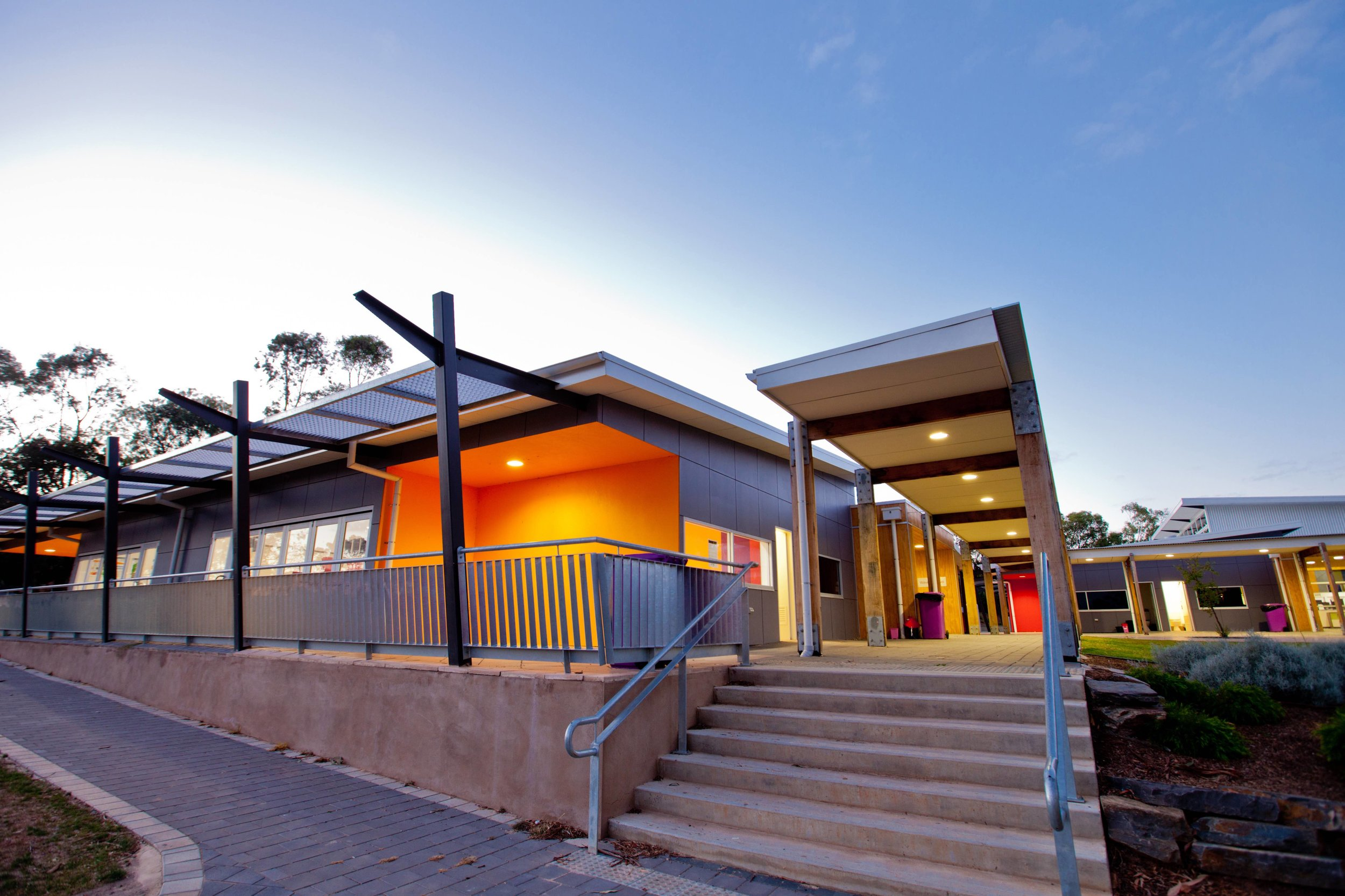 Willunga High School   Middle School Development   Services: Meinhardt Contractor: Building Solutions Photographer: Spruik Photography  Two linked buildings, each containing six classrooms accessed from a central circulation studio. Each classroom contains a breakout space as well as direct access to outdoor landscaped areas via cafe style doors.