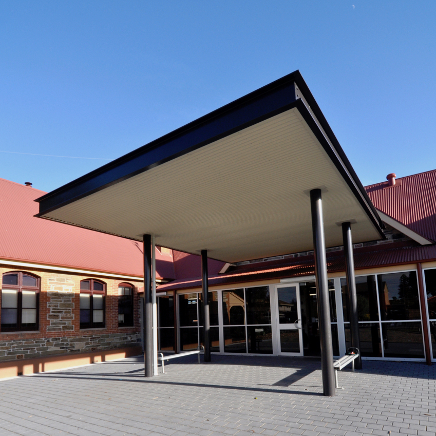 Plympton Primary School | Heritage Redevelopment   Services + Structural Engineering: Meinhardt Contractor: Happy Valley Homes Photographer: W+S  Redevelopment of the existing heritage building at Plympton Primary School, including new Entrance Canopy, Shade Structure, Entry Ramp and refurbishment of General Learning Areas, Library and Toilet facilities.