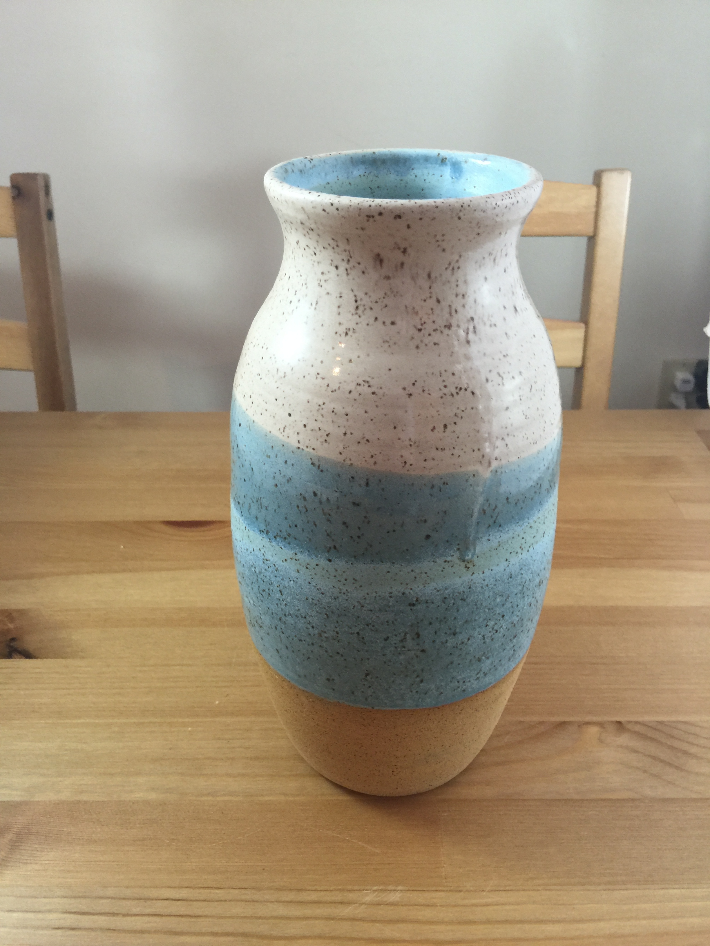 large teal and white vase