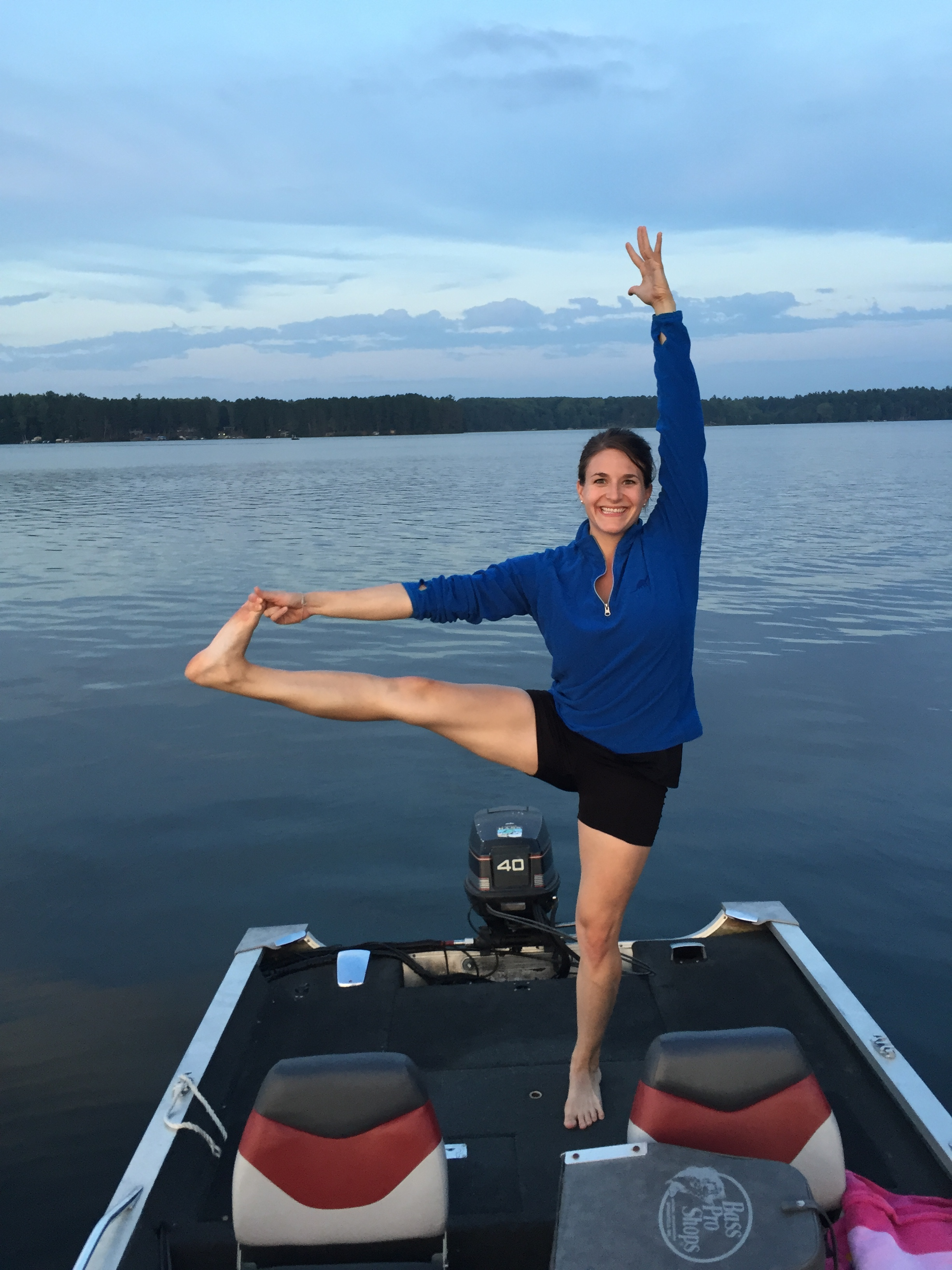 Lauren fitting in her yoga even on the lake!
