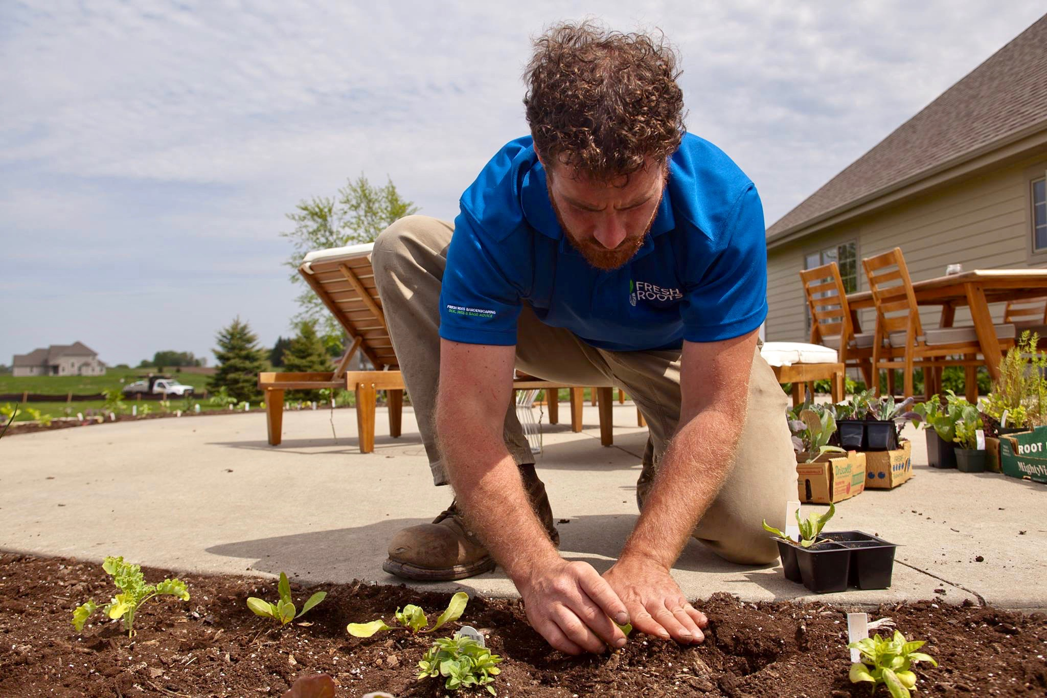Alec adds compost to his edible landscaping. To learn more about edible landscaping, visit his  website