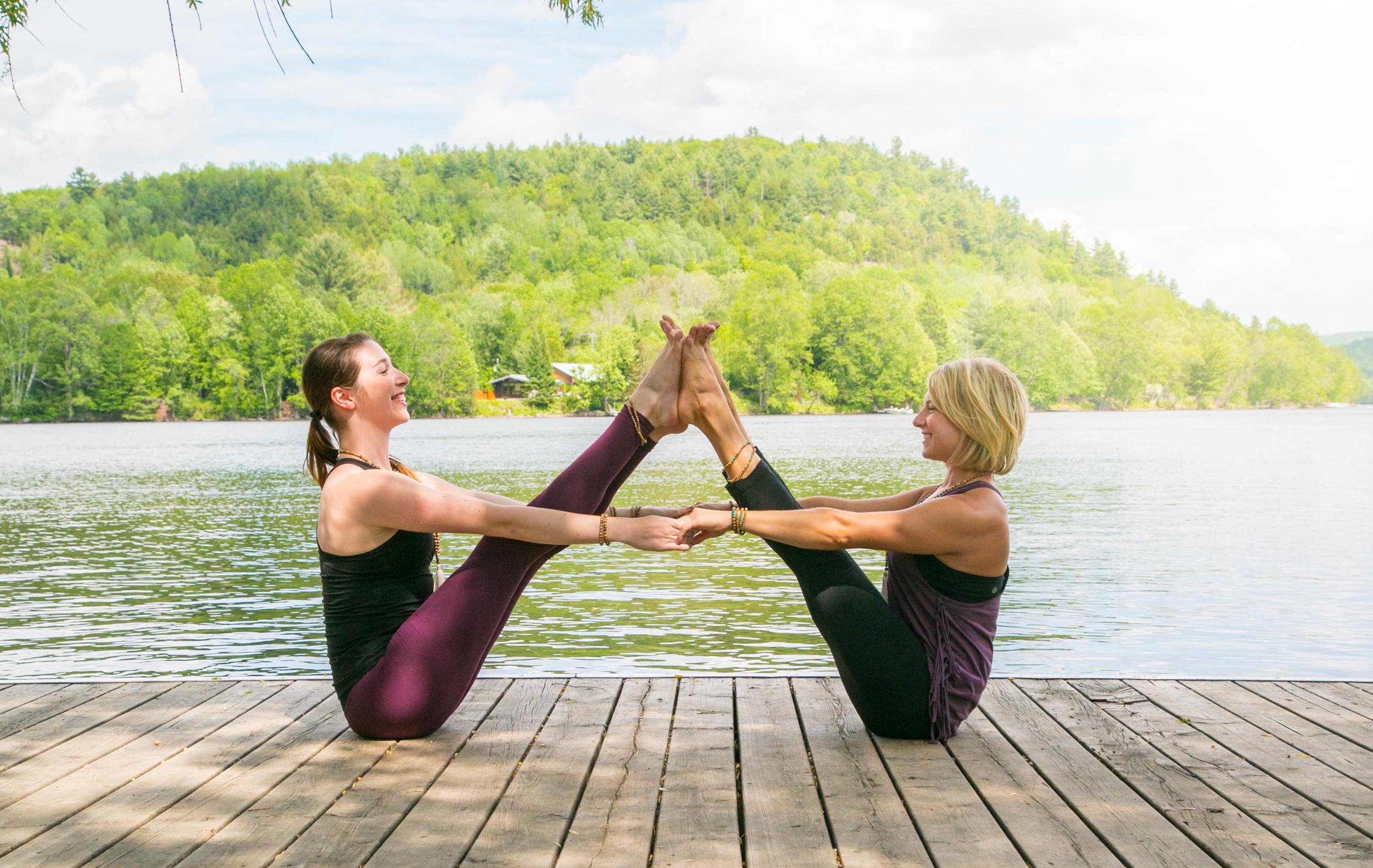 Partner Yoga with @yogawithkassandra wearing @MalaRae designs captured by Aida Robbins.