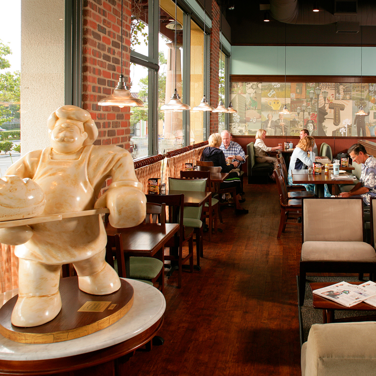 cafe interior with Baker Boy statue